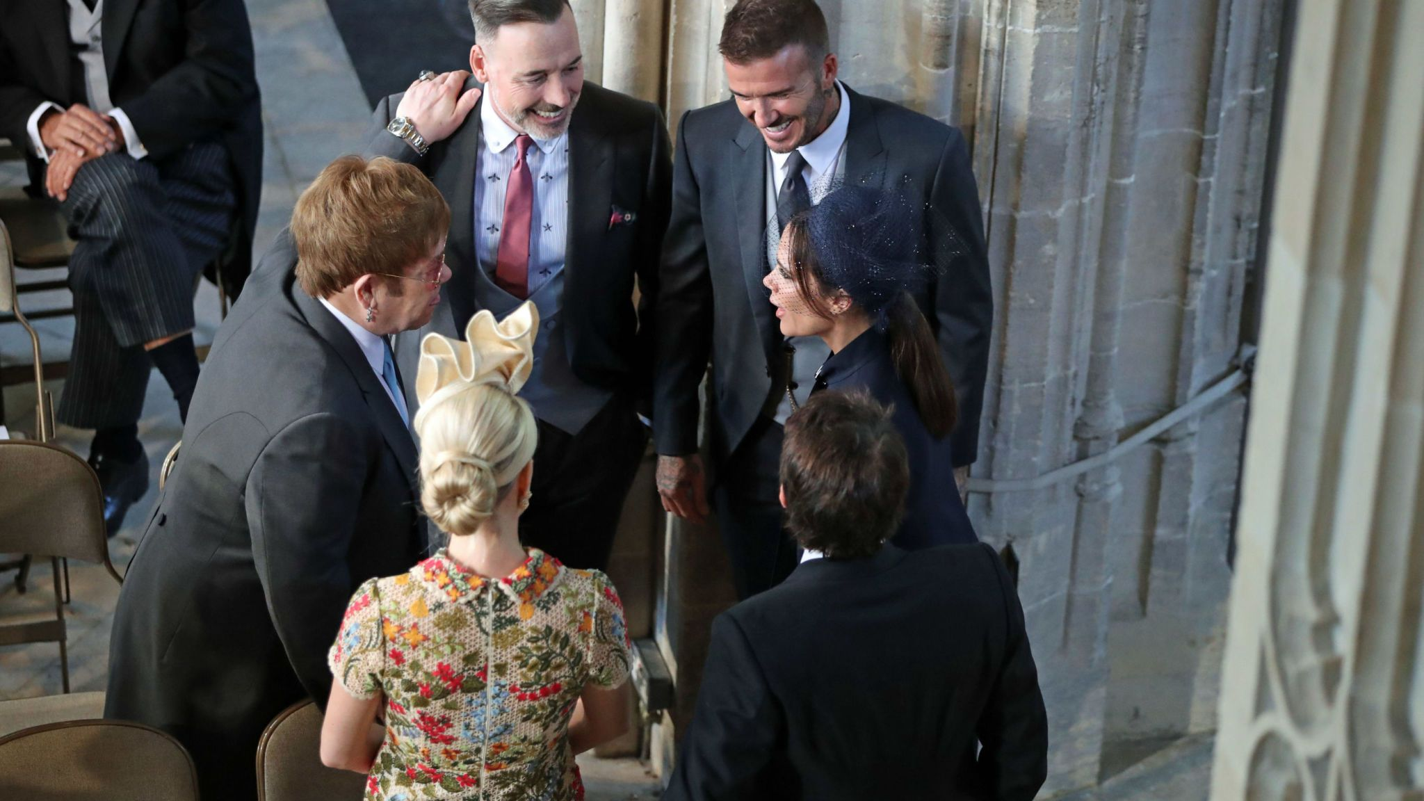 TOPSHOT - Former england footballer David Beckham and wife Victoria Beckham speak with British musician Elton John and partner David Furnish before the wedding ceremony of Britain's Prince Harry, Duke of Sussex and US actress Meghan Markle in St George's Chapel, Windsor Castle, in Windsor, on May 19, 2018