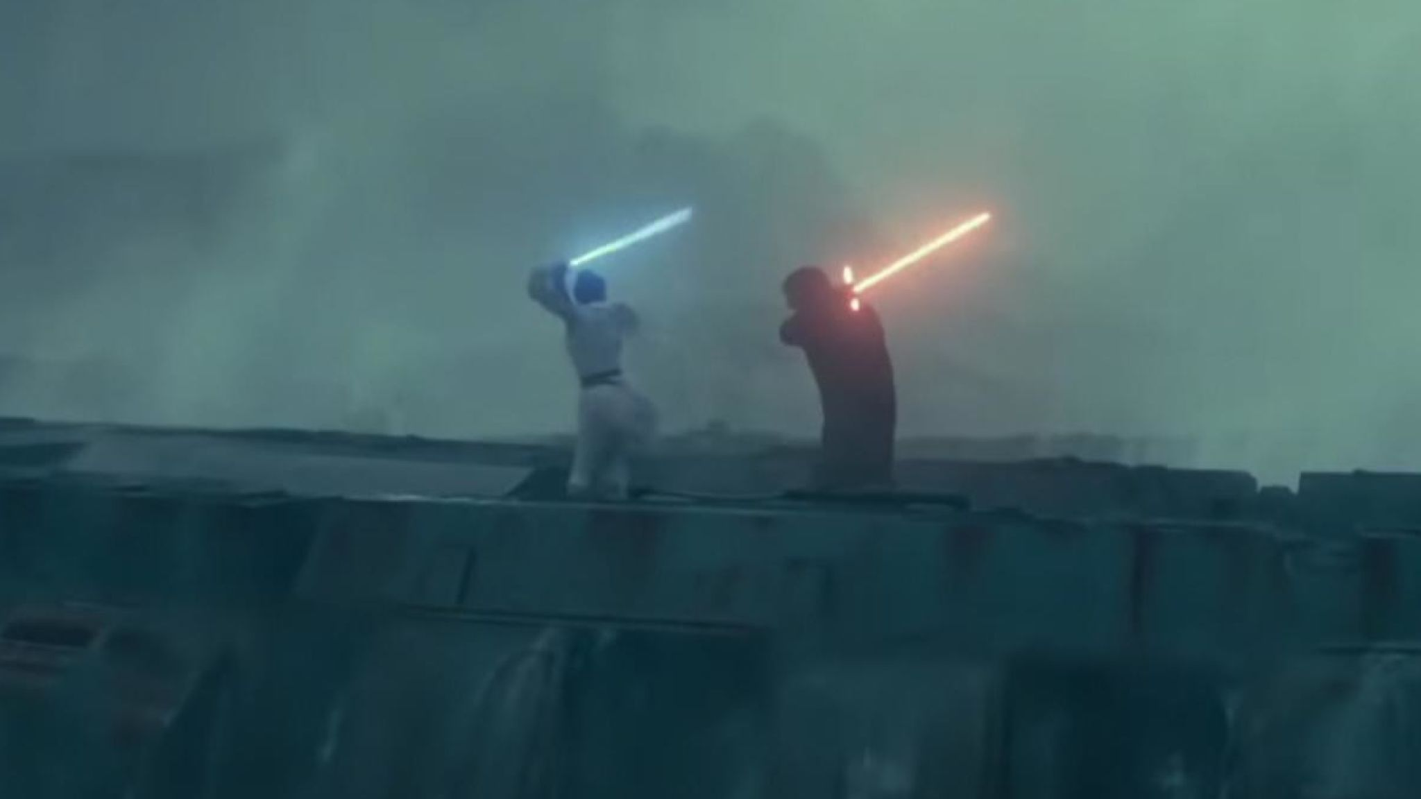 Rey and Kylo Ren face-off in a lightsaber duel