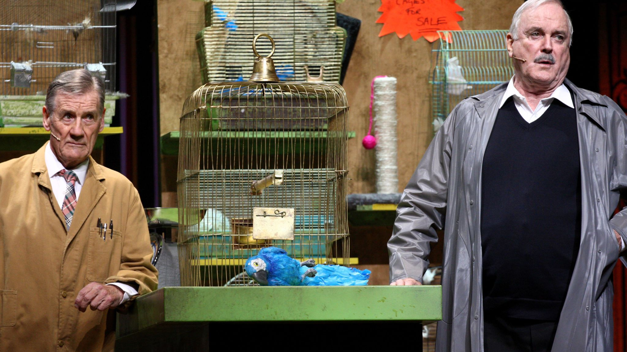 Michael Palin and John Cleese perform the famous parrot scene in 'Monty Python Live (Mostly)' in 2014
