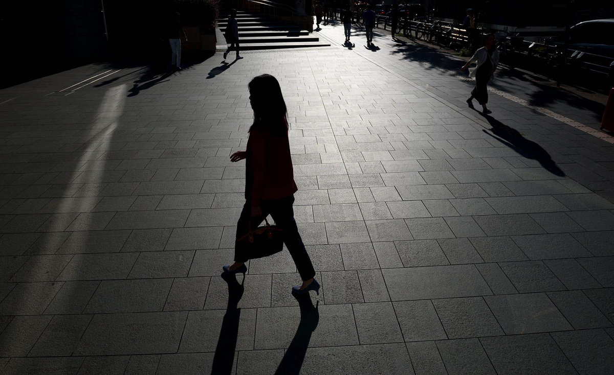 A woman walks near the Roppongi Hills complex in Tokyo on Sept. 29, 2017. MUST CREDIT: Bloomberg photo by Akio Kon,