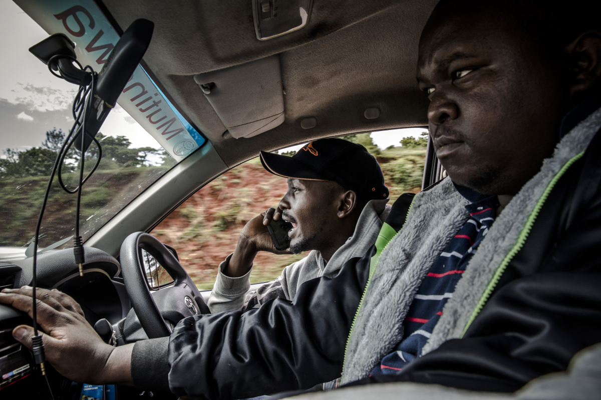 Benjamin Karenga speaks with clients while speeding his way to Nairobi to deliver fresh miraa. MUST CREDIT: Photo for The Washington Post by Luis Tato