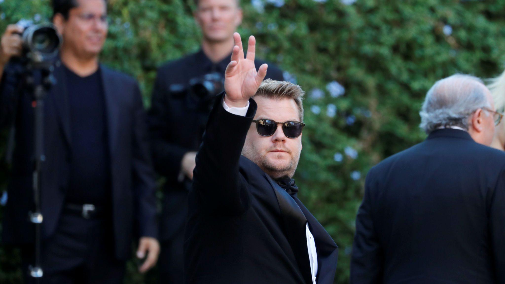 James Corden gestures as he attends the wedding