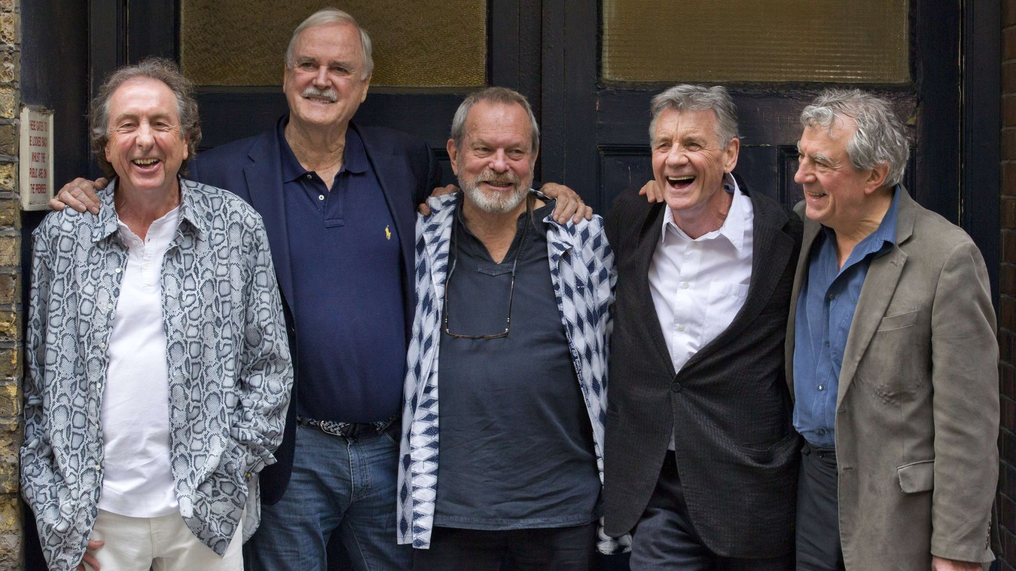 Monty Python pose for a photograph at the back door to the London Palladium in central London in 2014