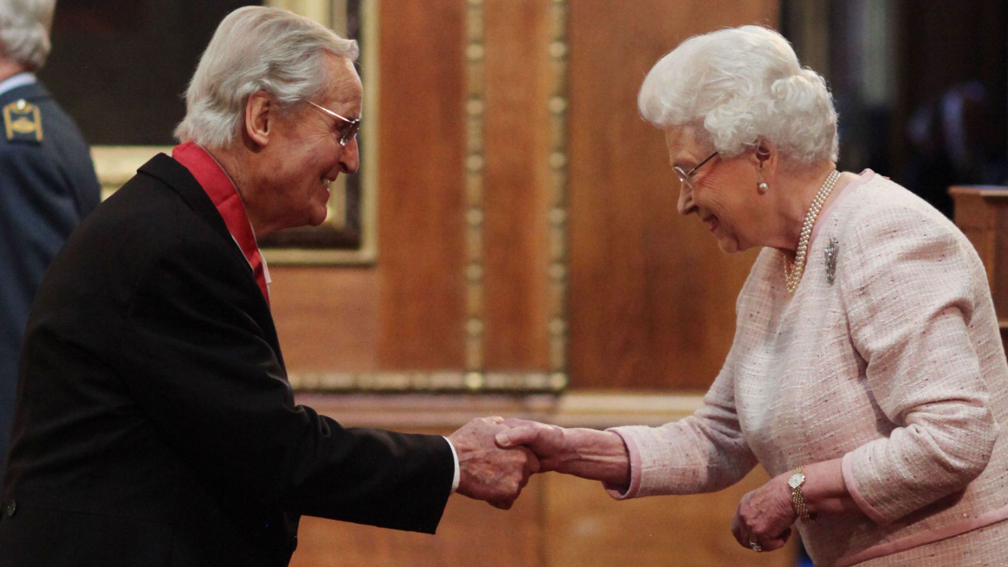 Nicholas Parsons is made a CBE (Commander of the Order of the British Empire) by Queen Elizabeth II at Windsor Castle