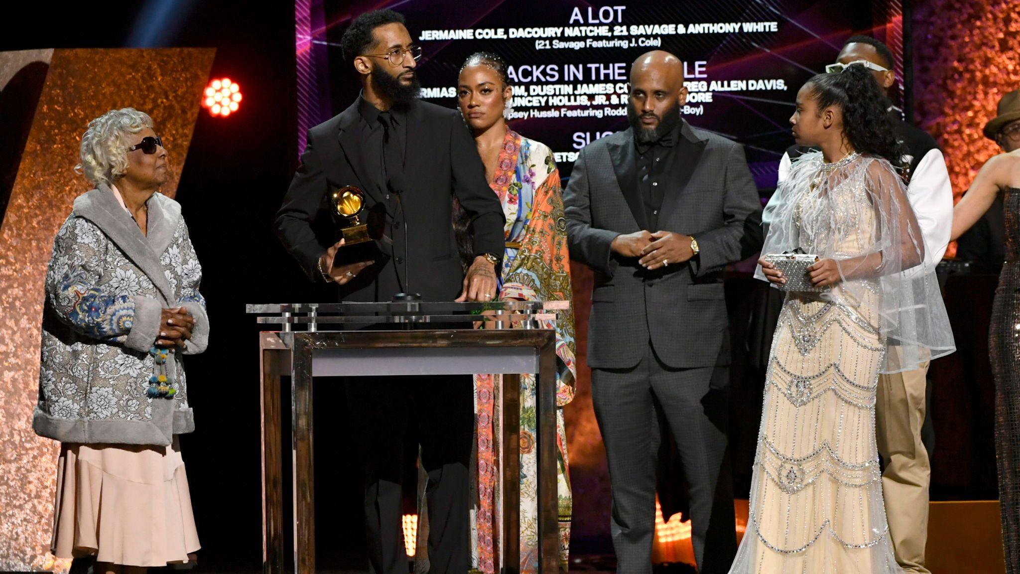 Nipsey Hussle's grandmother Margaret Bouffe, Samiel Asghedom, Nipsey Hussle's sister Samantha Smith and Nipsey Hussle's daughter Emani Asghedom accept Best Rap Performance for