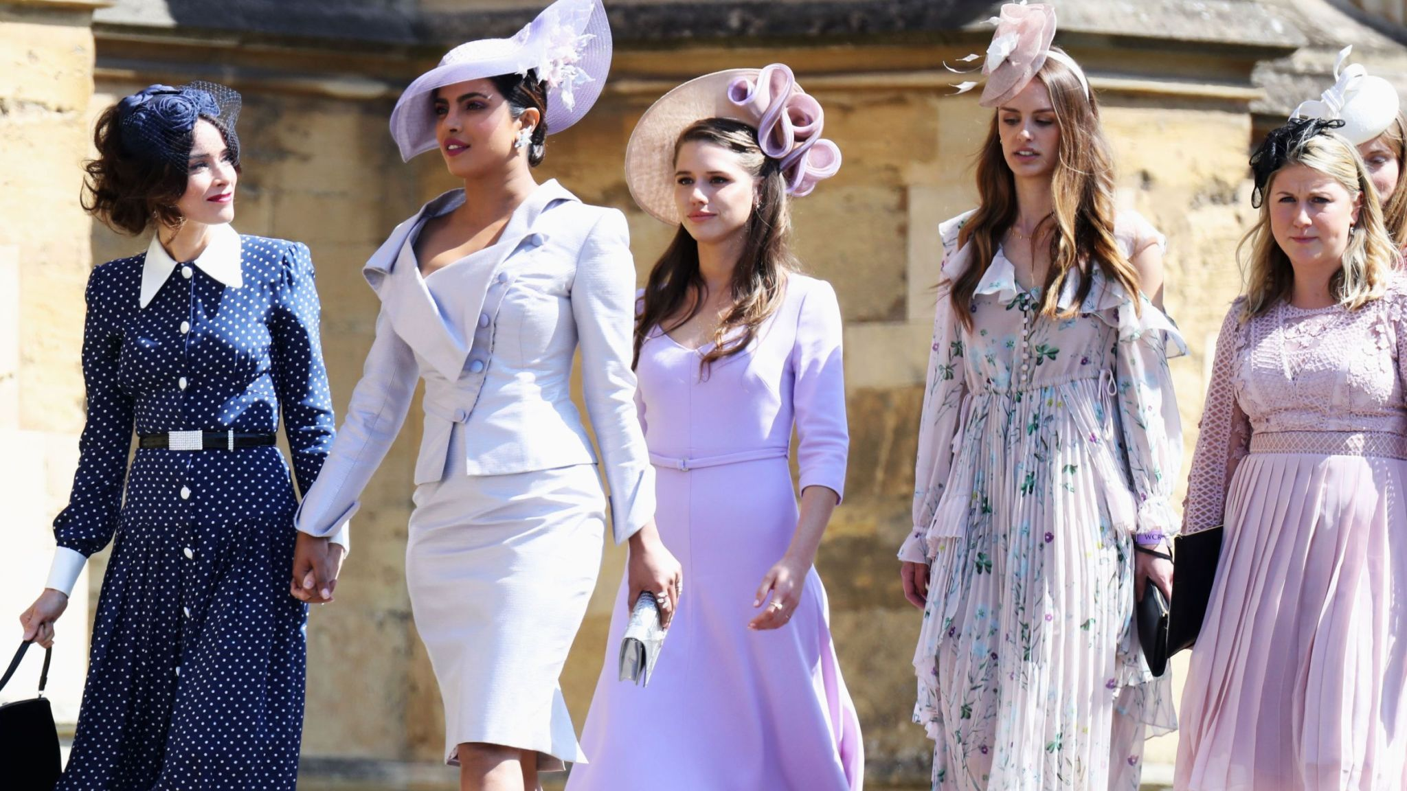 Priyanka Chopra (second left) arriving for Meghan Markle and Prince Harry's wedding in Windsor