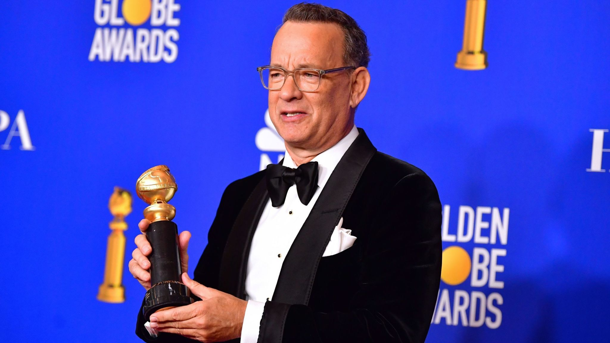 Golden Globes winner Tom Hanks with the Cecil B Demille lifetime achievement award
