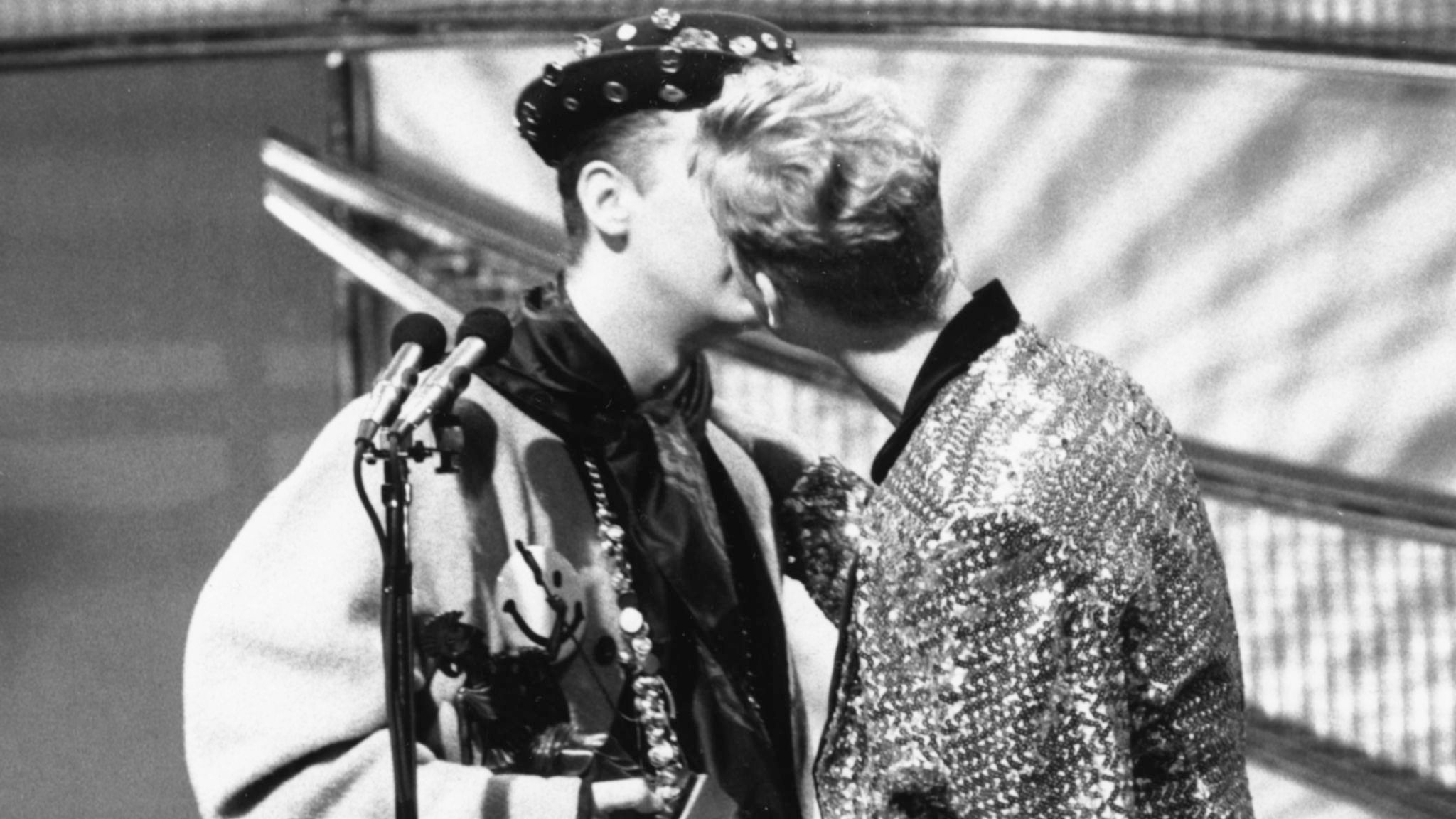 Singer Boy George, of the band Culture Club, kissing Andy Bell, of the band 'Erasure', in 1989