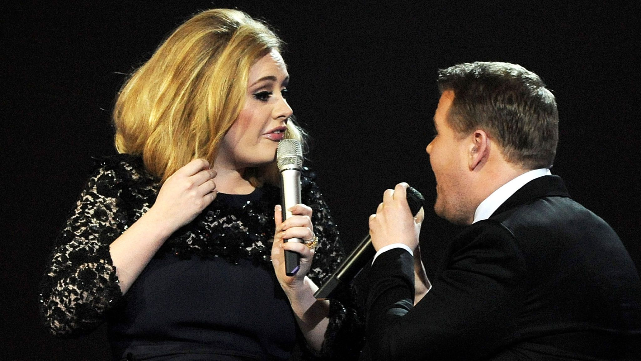Adele is interrupted by James Corden while accepting her award in 2012. Pic: Dave M. Benett/Getty Images