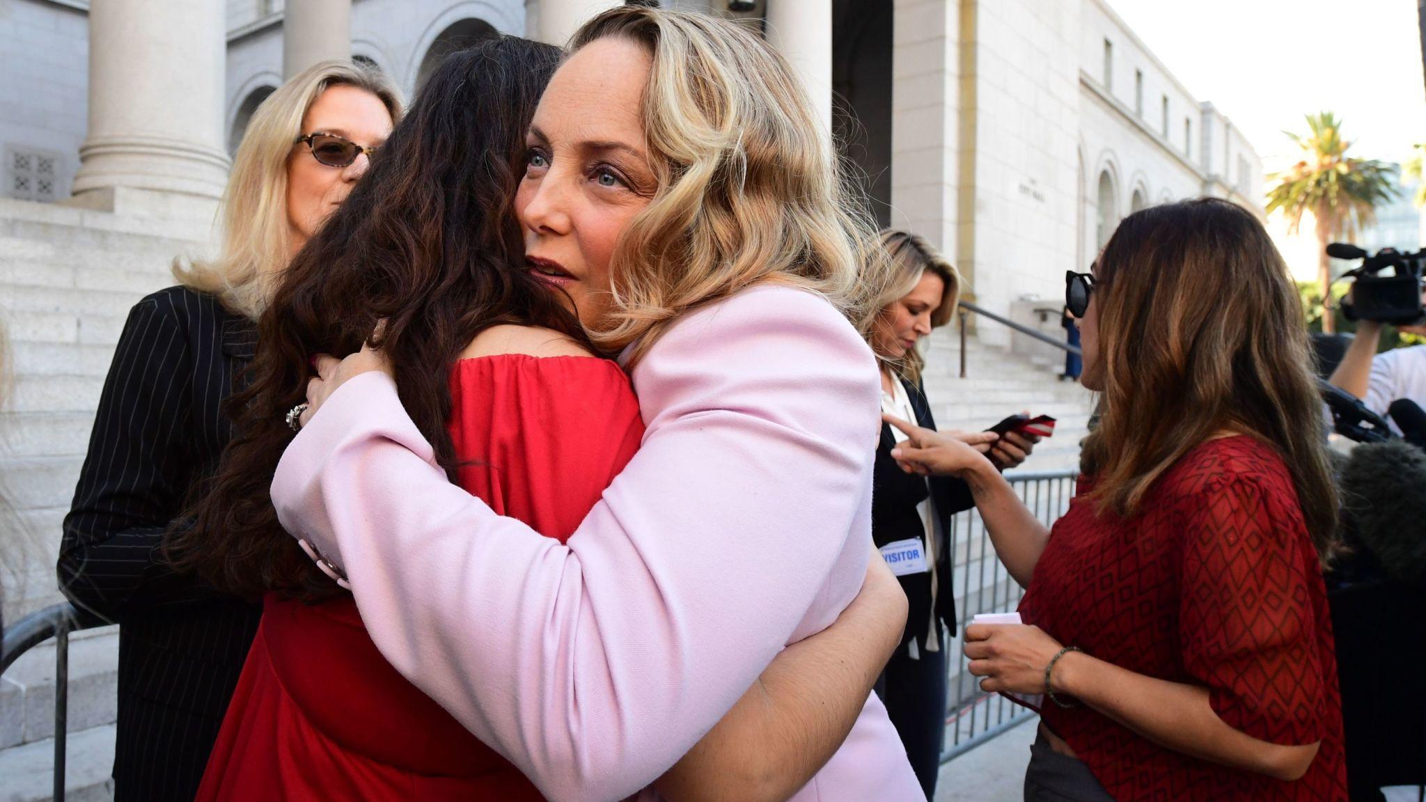 Louisette Geiss (R) embraces Sarah Ann Masse