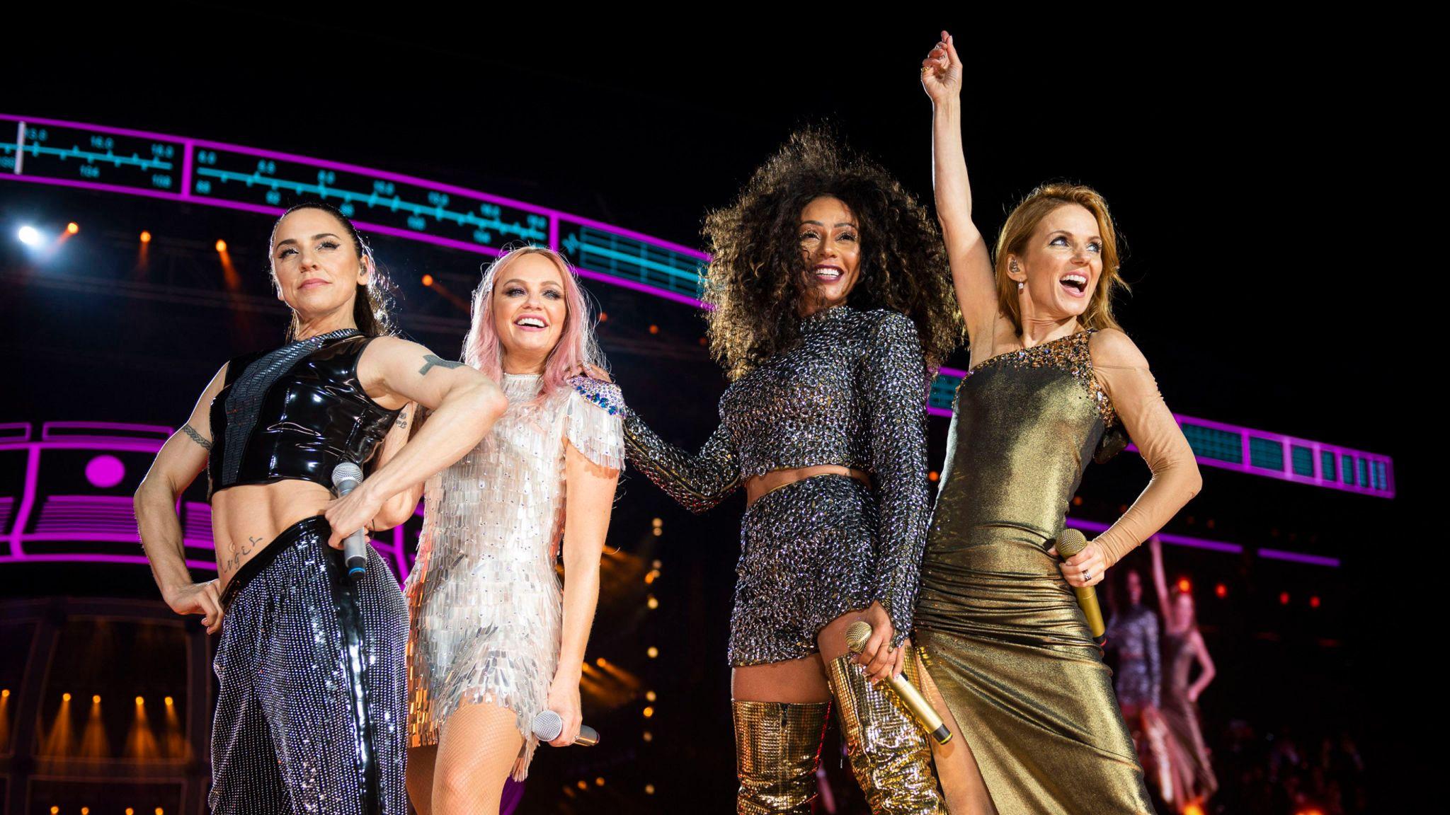 Melanie Chisholm, Emma Bunton, Melanie Brown and Geri Horner of the Spice Girls in concert at Wembley Stadium