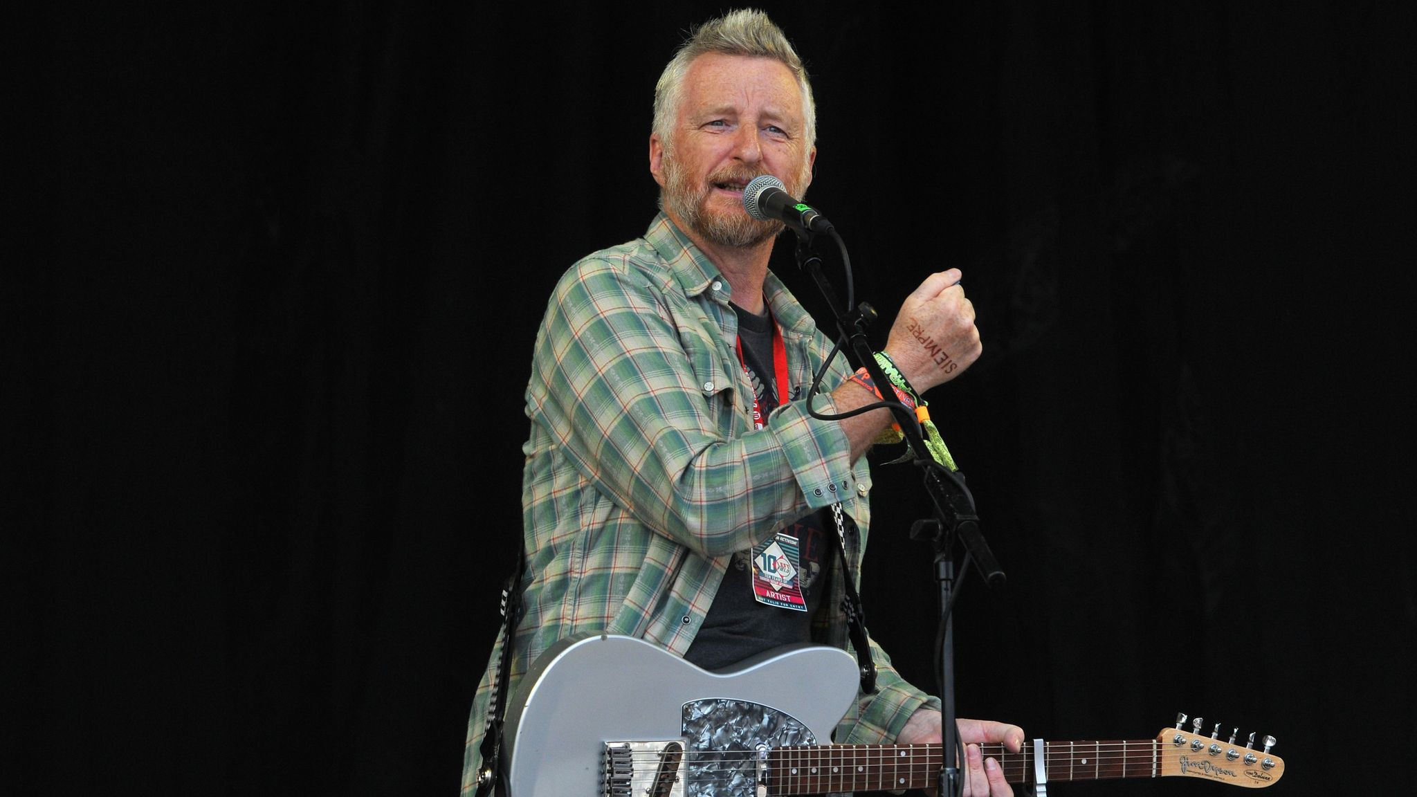 Billy Bragg performs on the Pyramid stage during day three of the Glastonbury Festival at Worthy Farm in Pilton on June 29, 2014 in Glastonbury, England