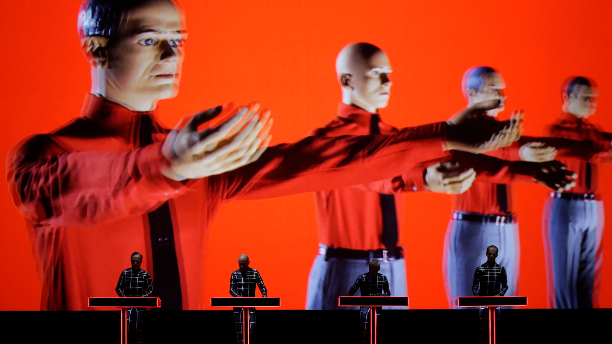 The groups continues to perform, with the visuals as important as the music
