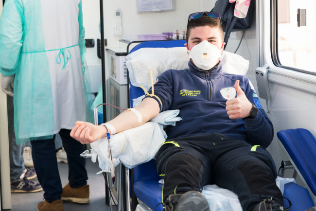 man donating blood coronavirus plasma - shutterstock