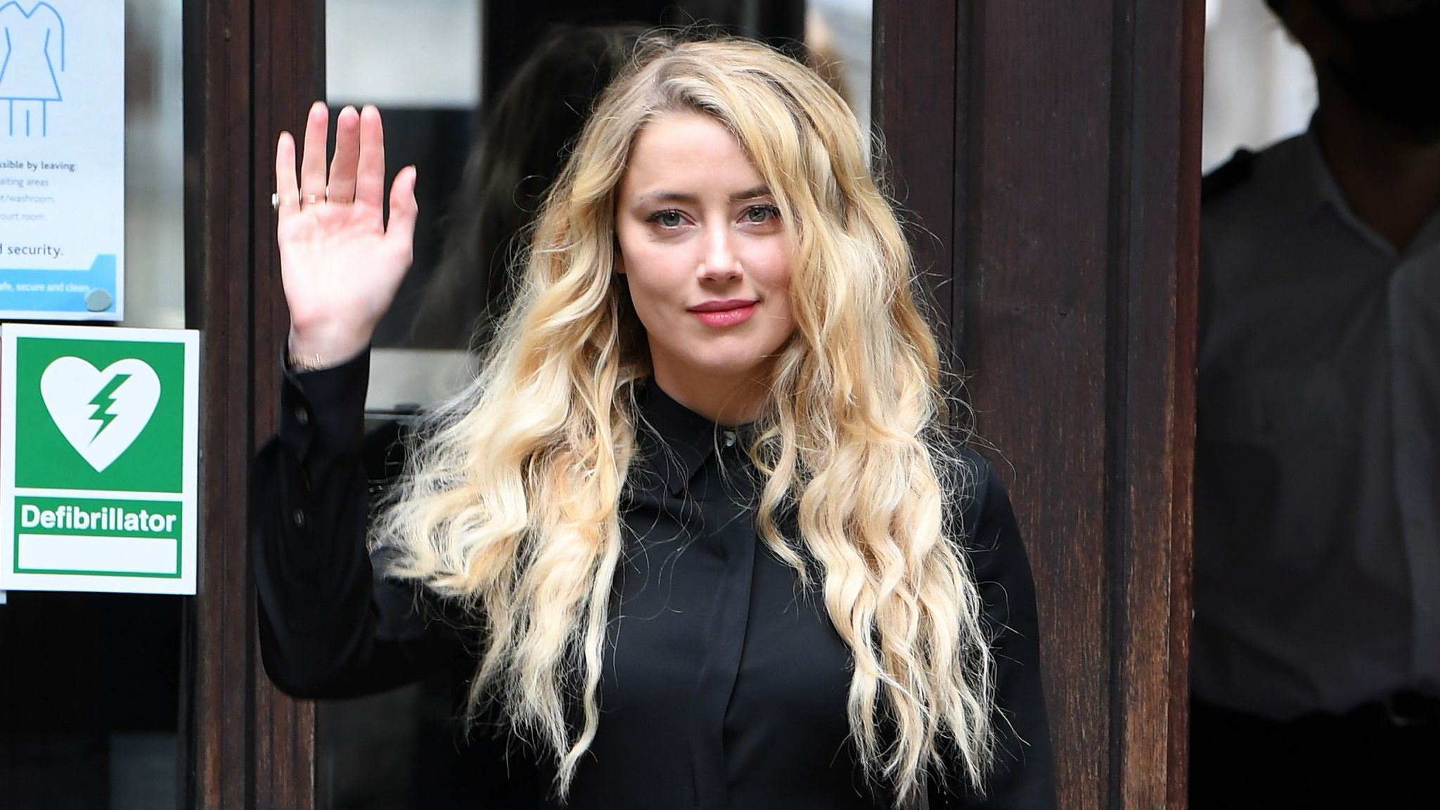 """LONDON, ENGLAND - JULY 28: Amber Heard arrives at the Royal Courts of Justice, the Strand on July 28, 2020 in London, England. The Hollywood actor Johnny Depp is suing News Group Newspapers (NGN) and the Sun's executive editor, Dan Wootton, over an article published in 2018 that referred to him as a """"wife beater"""" during his marriage to actor Amber Heard. (Photo by Stuart C. Wilson/Getty Images)"""