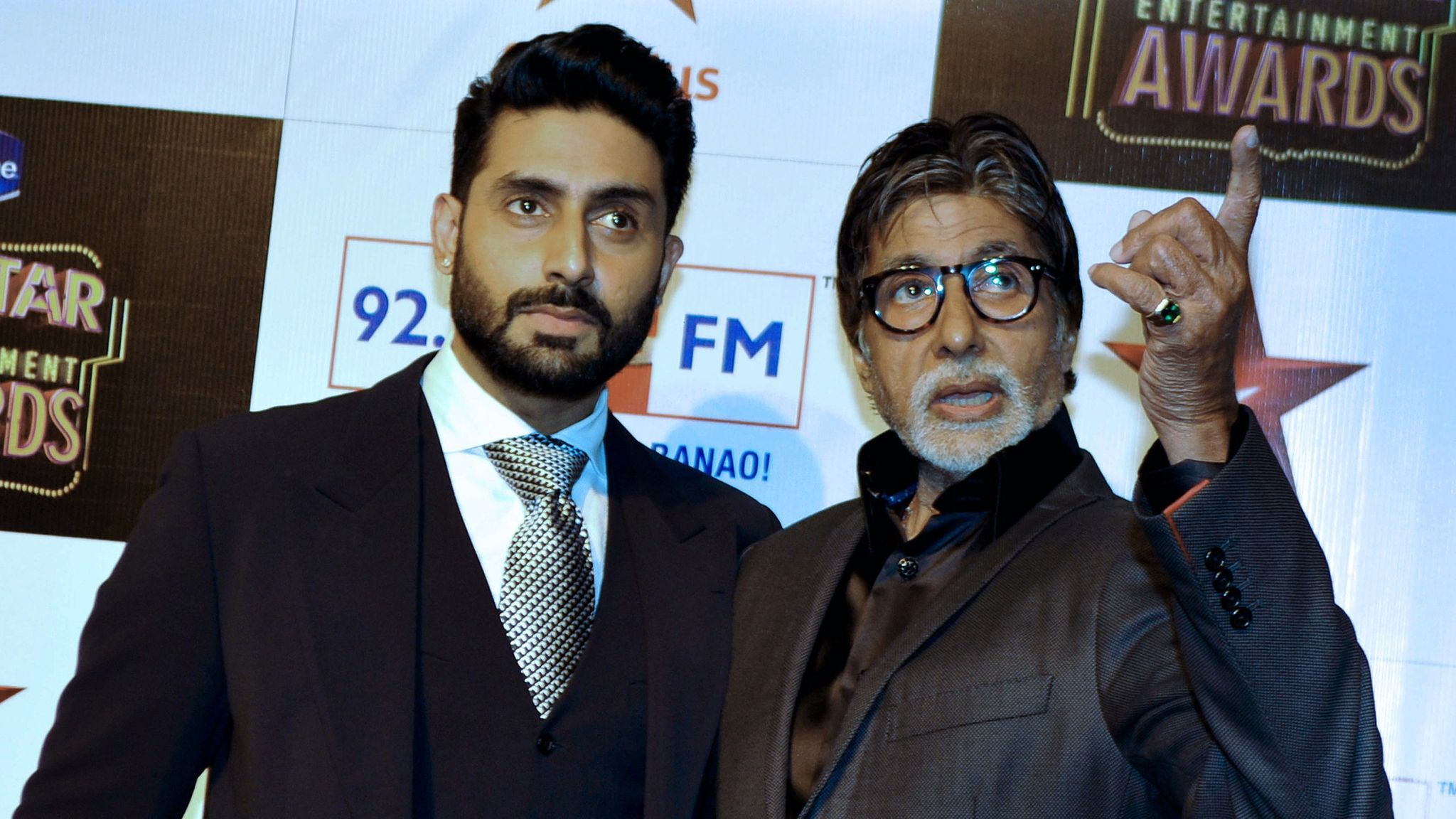 Amitabh's son Abhishek Bachchan (L) has also tested positive for COVID-19