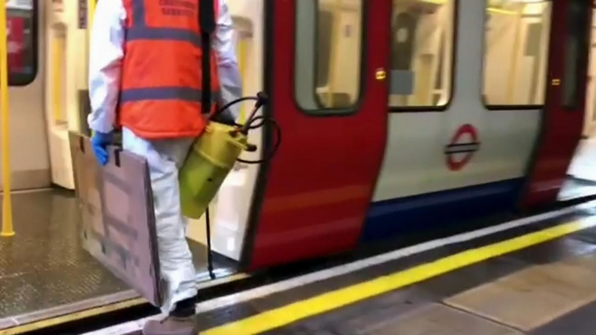 Banksy can be seen getting onto the Tube with a spray paint pump. Pic: Banksy