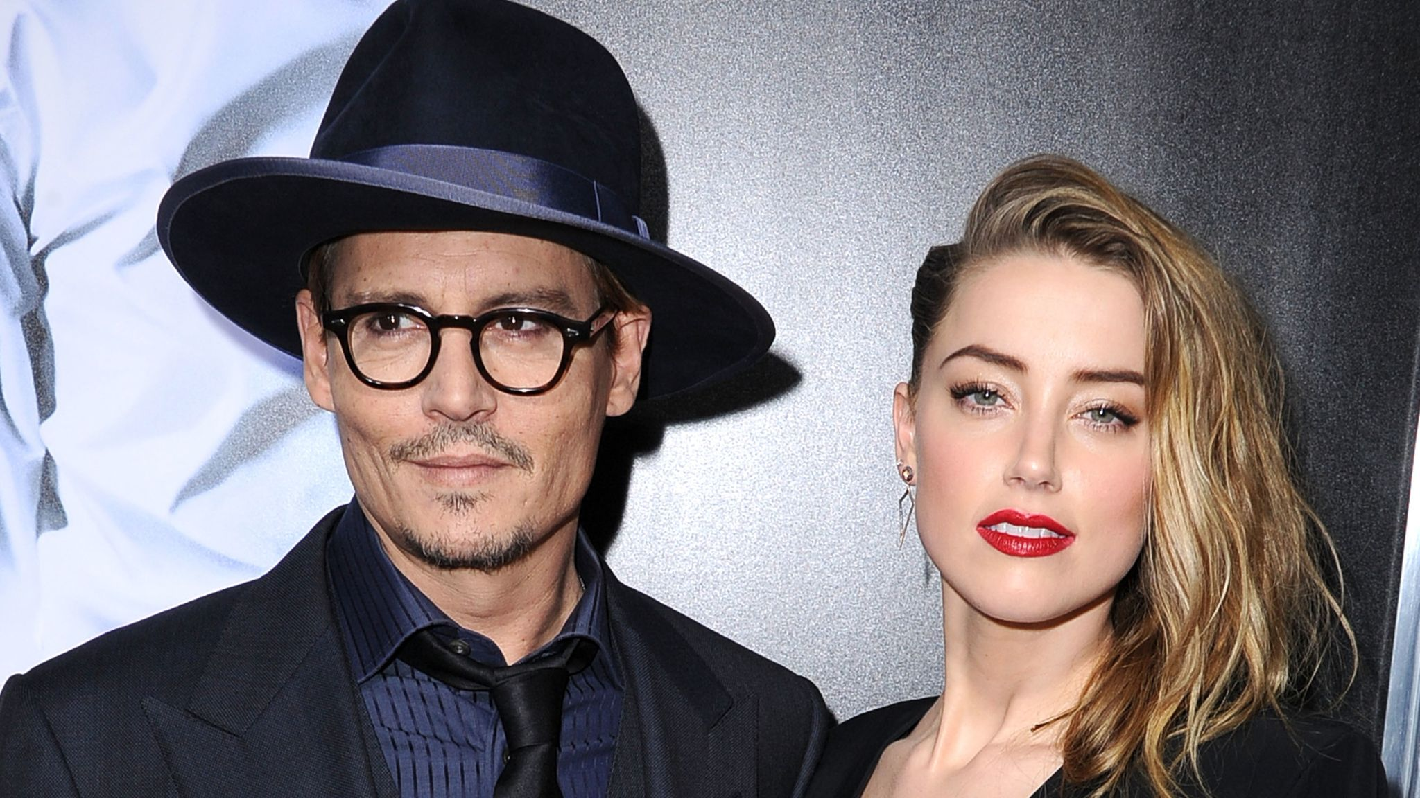 """Johnny Depp and Amber Heard arrive at the """"3 Days To Kill"""" at ArcLight Cinemas on February 12, 2014 in Hollywood, California."""