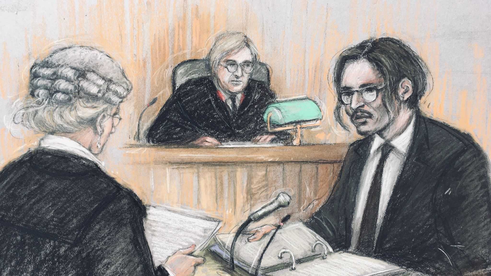 Court artist sketch by Elizabeth Cook of actor Johnny Depp (right) being cross-examined by Sasha Wass QC (left) before the judge, Mr Justice Nicol, at the High Court in London during a hearing in his libel case against the publishers of The Sun and its executive editor, Dan Wootton.