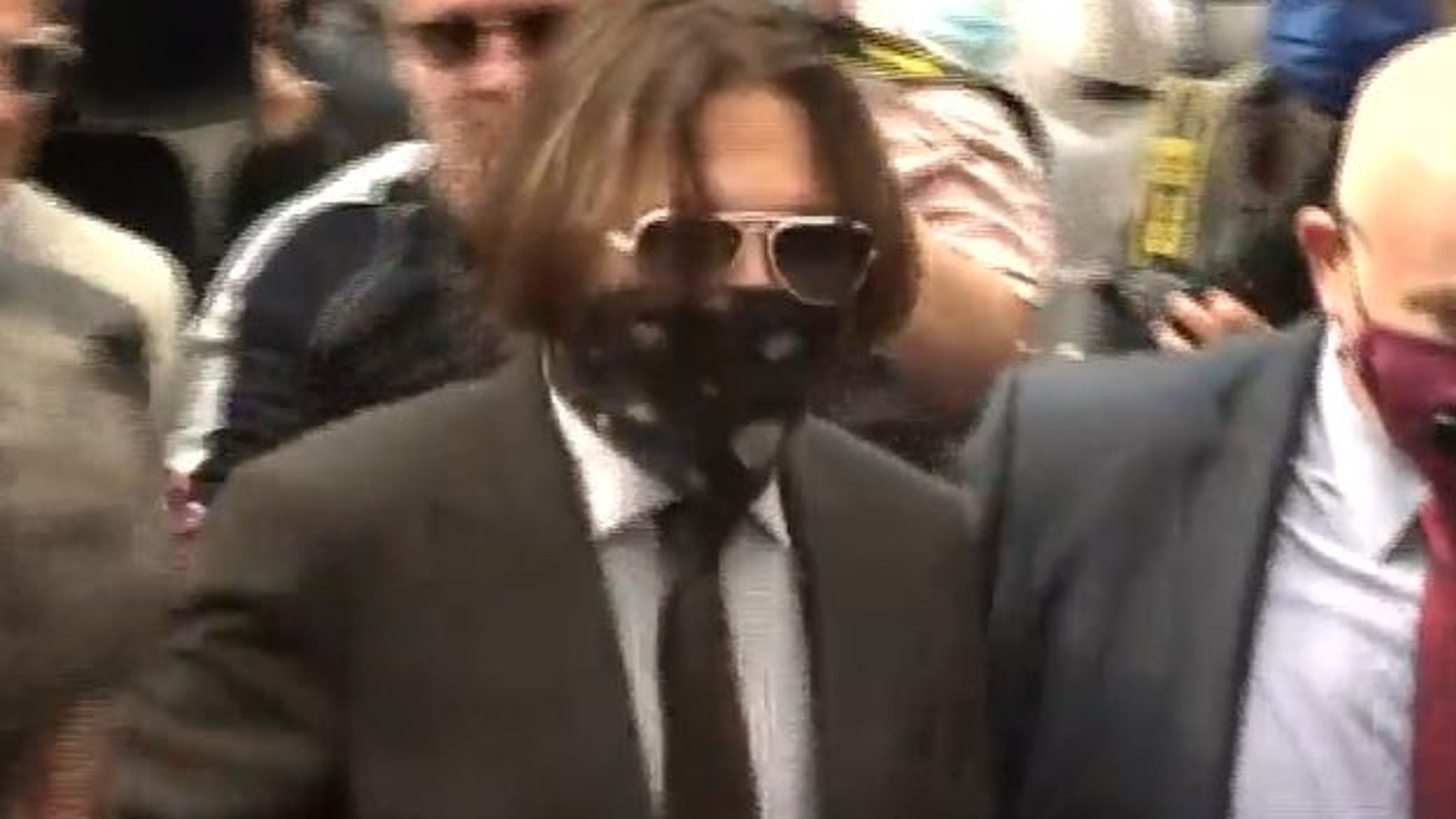 Johnny Depp swamped by photographers as he arrives for another day of libel trial