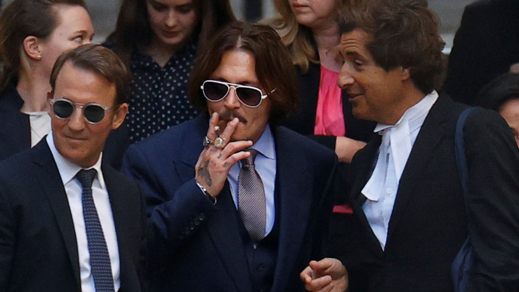 Johnny Depp and his team leave the High Court on 17 July