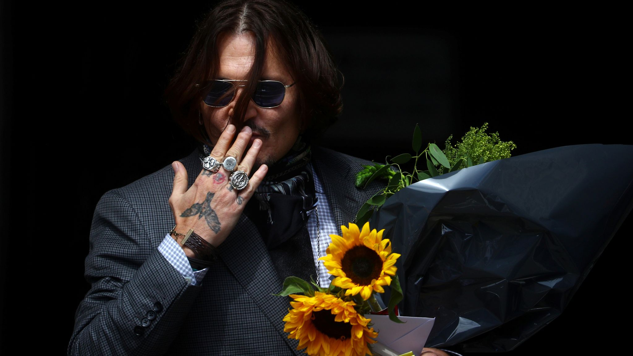 Johnny Depp arriving at the High Court on 23 July