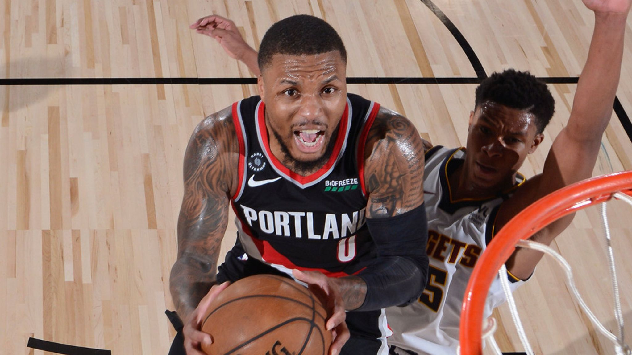 Damian Lillard rises to score at the rim against the Denver Nuggets
