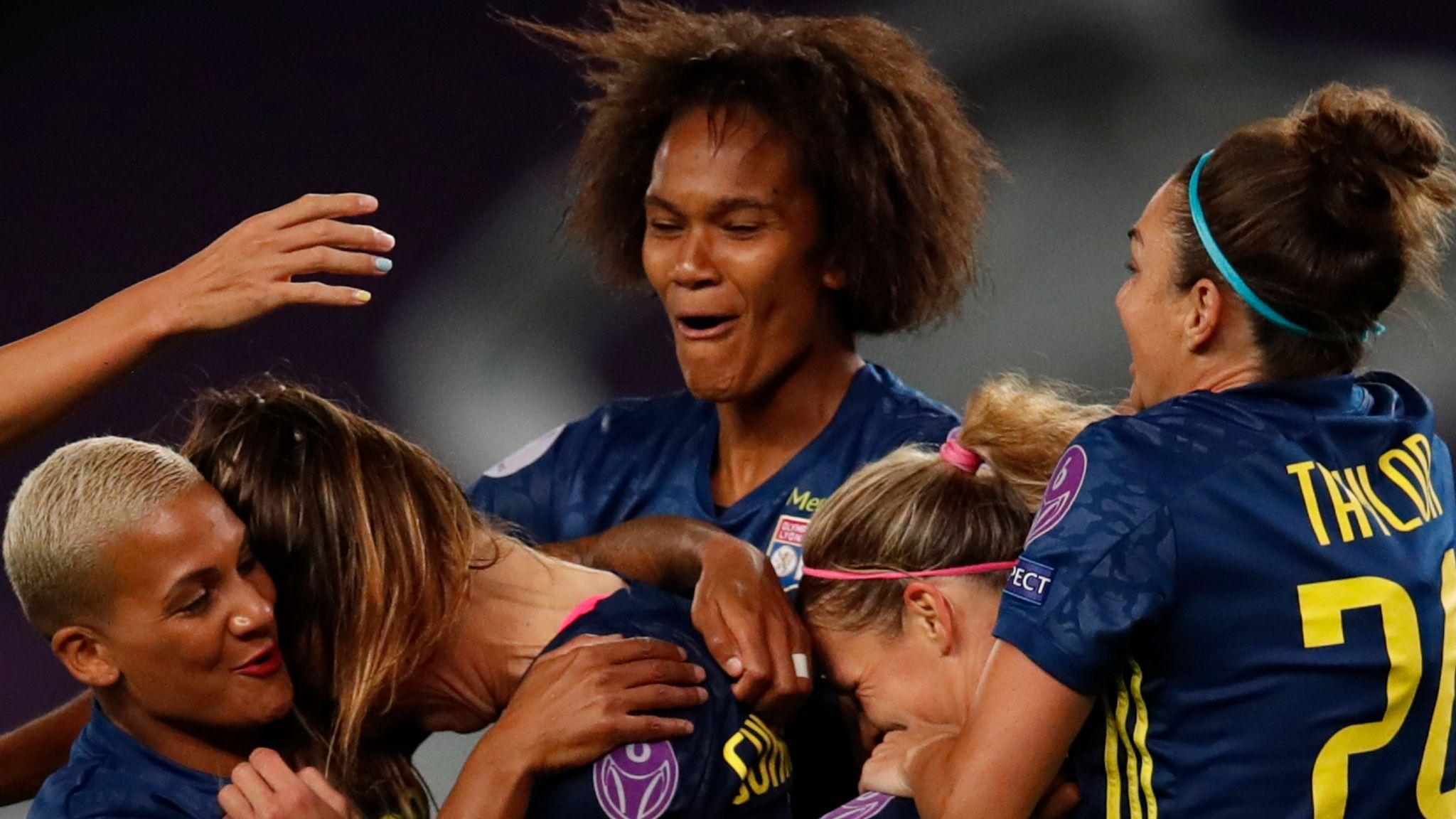 Lyon celebrate their third goal against Wolfsburg