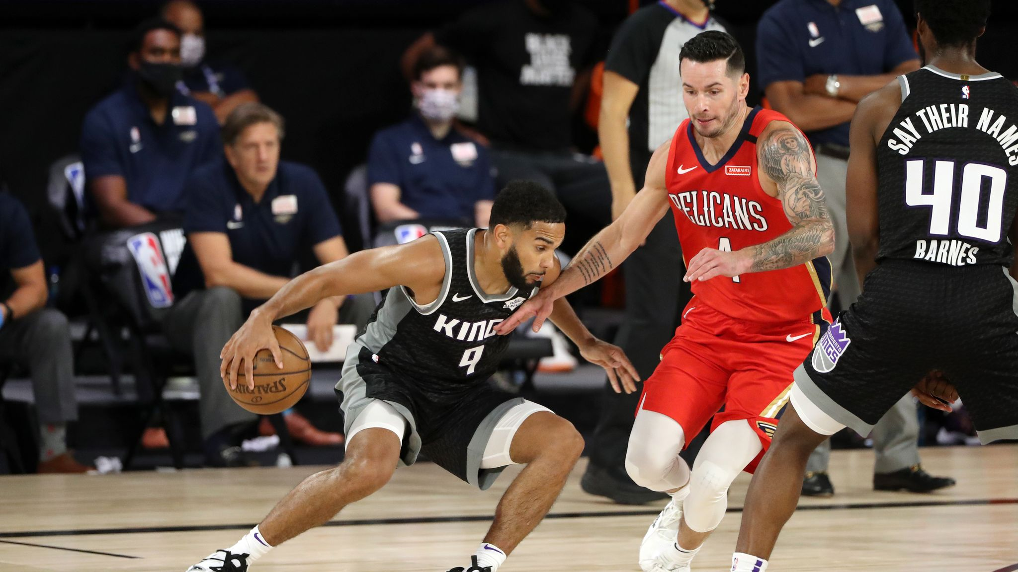 Cory Joseph #9 of the Sacramento Kings handles the ball during the game against the New Orleans Pelicans on August 6, 2020 at The HP Field House at ESPN Wide World Of Sports Complex in Orlando, Florida.