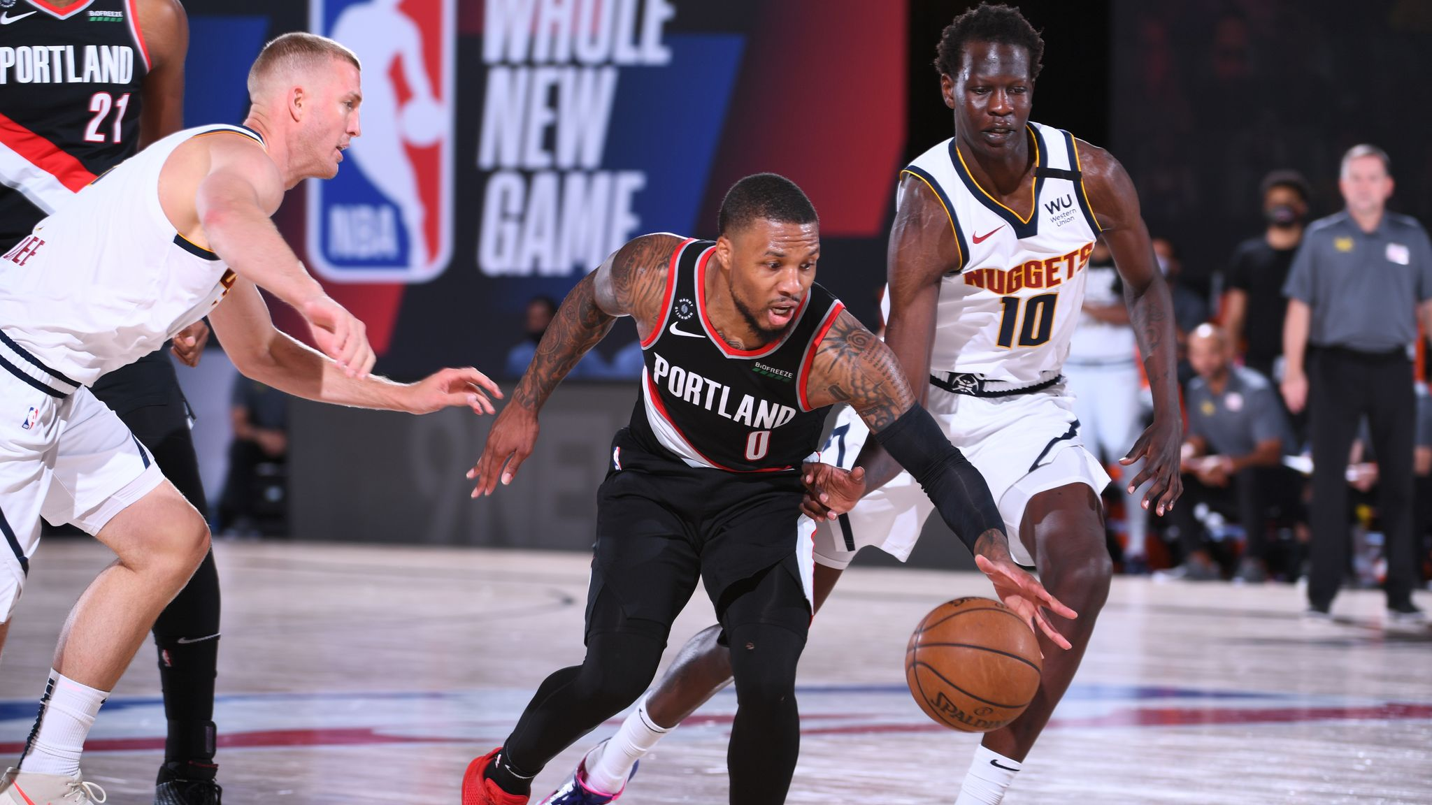 Damian Lillard #0 of the Portland Trail Blazers handles the ball against the Denver Nuggets on August 6, 2020 at Visa Athletic Center at ESPN Wide World of Sports in Orlando, Florida.