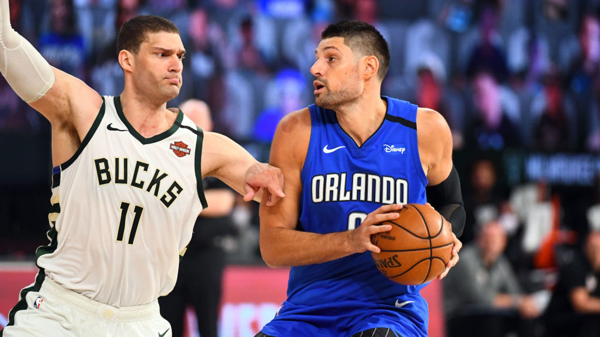 Nikola Vucevic #9 of the Orlando Magic handles the ball during the game against the Milwaukee Bucks during Round One, Game One of the NBA Playoffs on August 18, 2020 at The Field House at ESPN Wide World Of Sports Complex in Orlando,