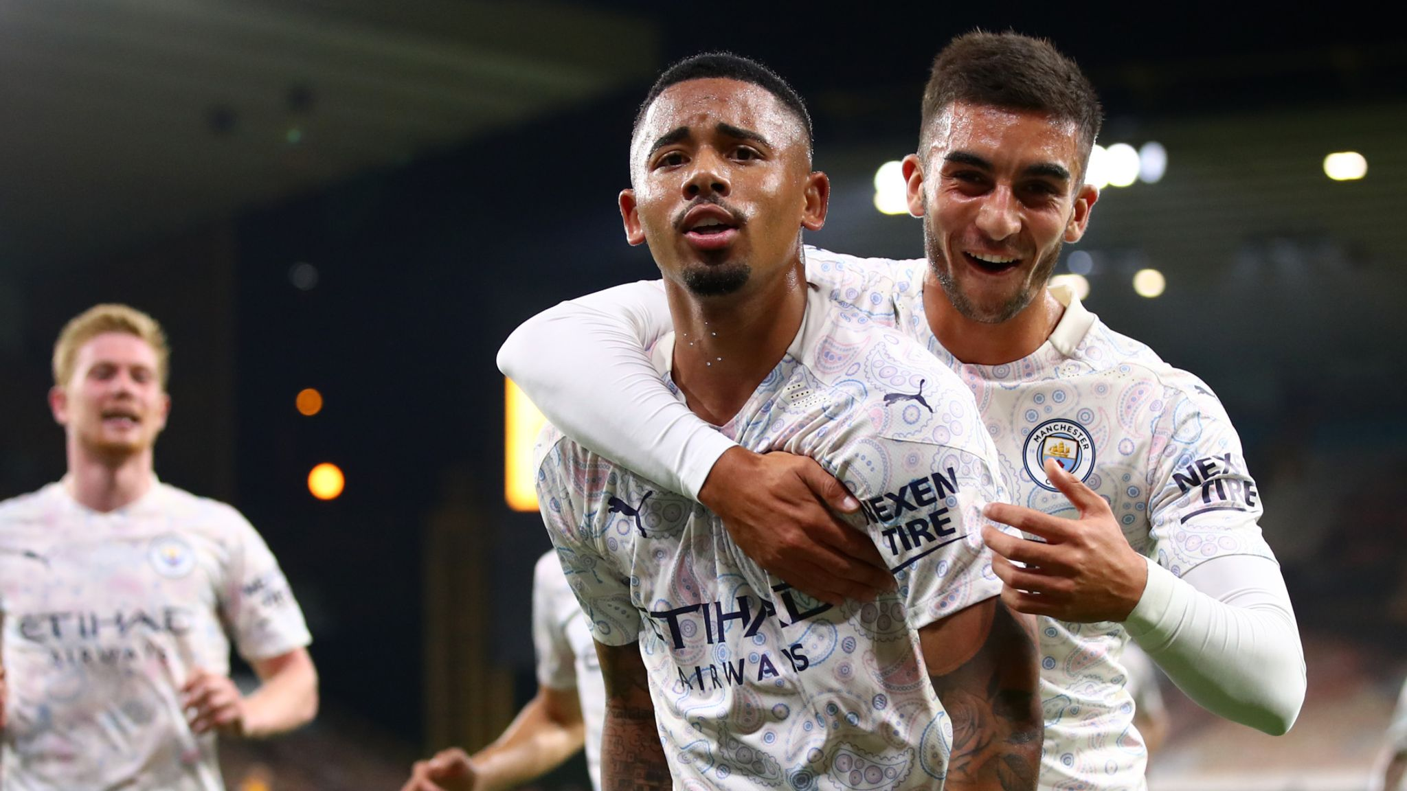 Gabriel Jesus celebrates his late goal with Ferran Torres