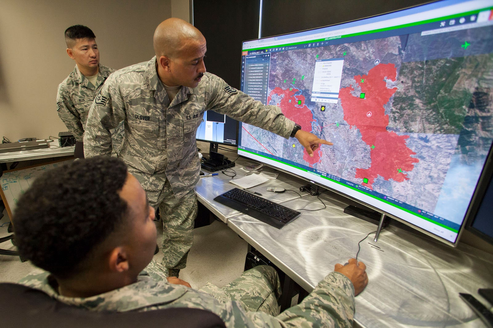 Image may contain Human Person Electronics Monitor Display Screen Military Uniform Military and Computer Keyboard