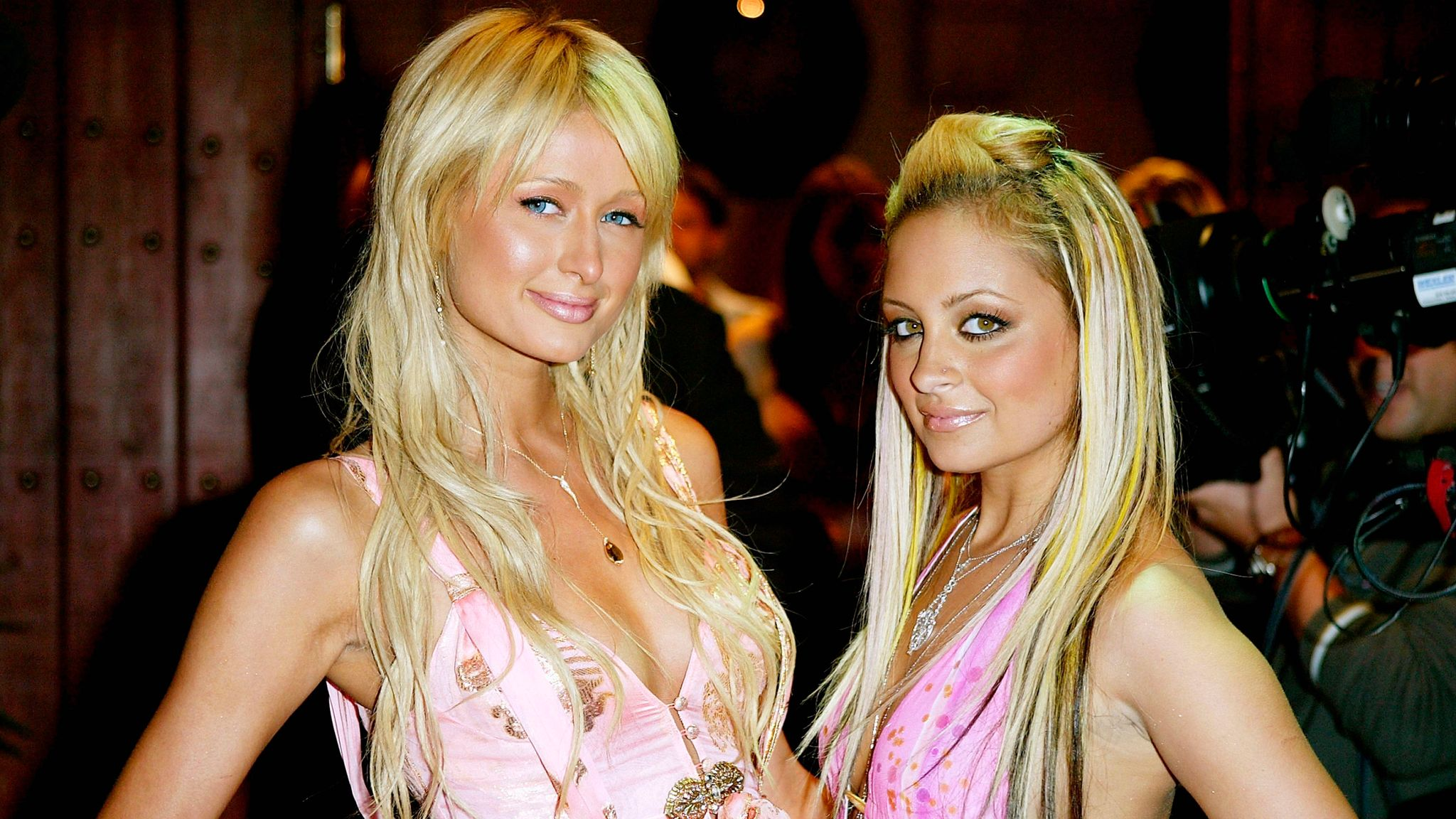 """Nicole Richie and Paris Hilton (L) aririve for the """"Simple Life 2"""" Welcome Home Party at The Spider Club on April 14, 2004 in Hollywood, California"""