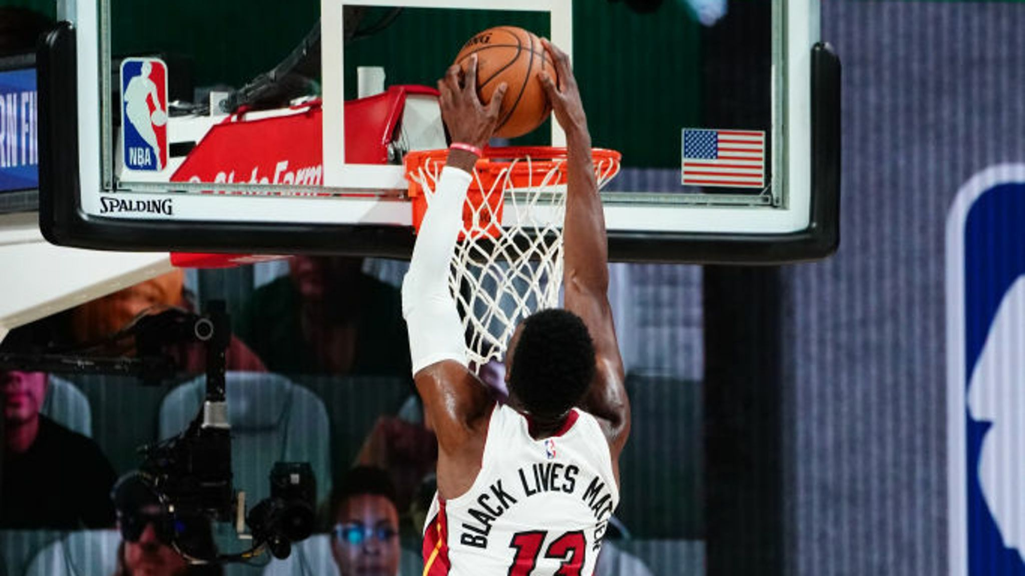Bam Adebayo #13 of the Miami Heat dunks the ball against the Boston Celtics during Game Two of the Eastern Conference Finals of the NBA Playoffs on September 17, 2020 at the AdventHealth Arena at ESPN Wide World Of Sports Complex in Orlando, Florida.