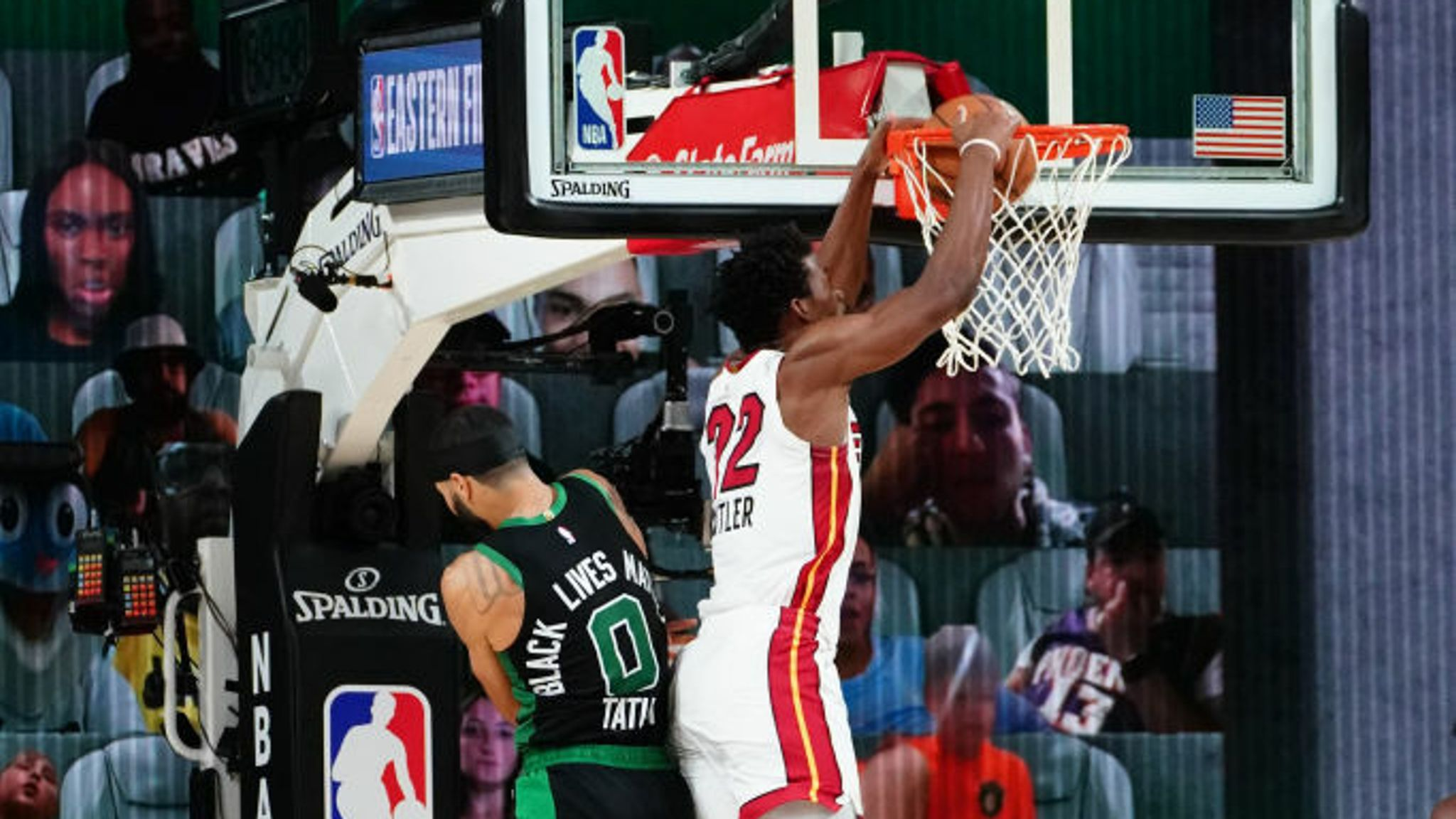 Jimmy Butler #22 of the Miami Heat dunks the ball against Jayson Tatum #0 of the Boston Celtics during Game Two of the Eastern Conference Finals of the NBA Playoffs on September 17, 2020 at the AdventHealth Arena at ESPN Wide World Of Sports Complex in Orlando, Florida.
