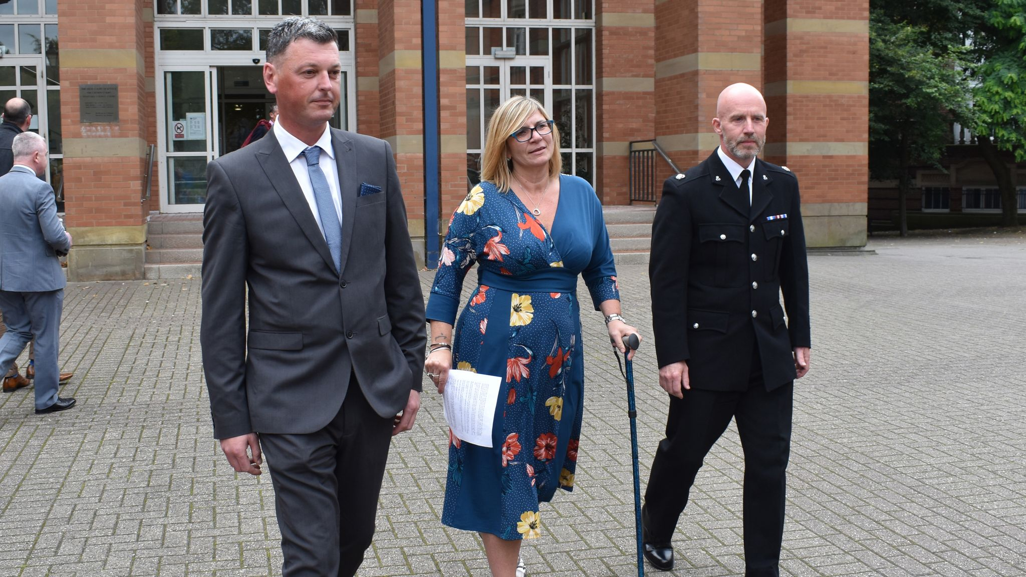 (left to right) PC Dave Mullins, PC Claire Bond and Supt Carl Ratcliffe leaving Stafford Crown Court to make a statement to the media, as a drug-dealer whose car crushed Claire Bond into a fence, causing fractures to her leg and knee, has been jailed for 12 years and nine months. PRESS ASSOCIATION Photo. Picture date: Monday September 02, 2019. Stafford Crown Court was told the police officer feared for her life and those of runners taking part in a nearby 10-kilometre road race, as she was thrown to the ground by banned driver Gurajdeep Malhi's rented BMW. See PA story COURTS Stafford. Photo credit should read: Matthew Cooper/PA Wire