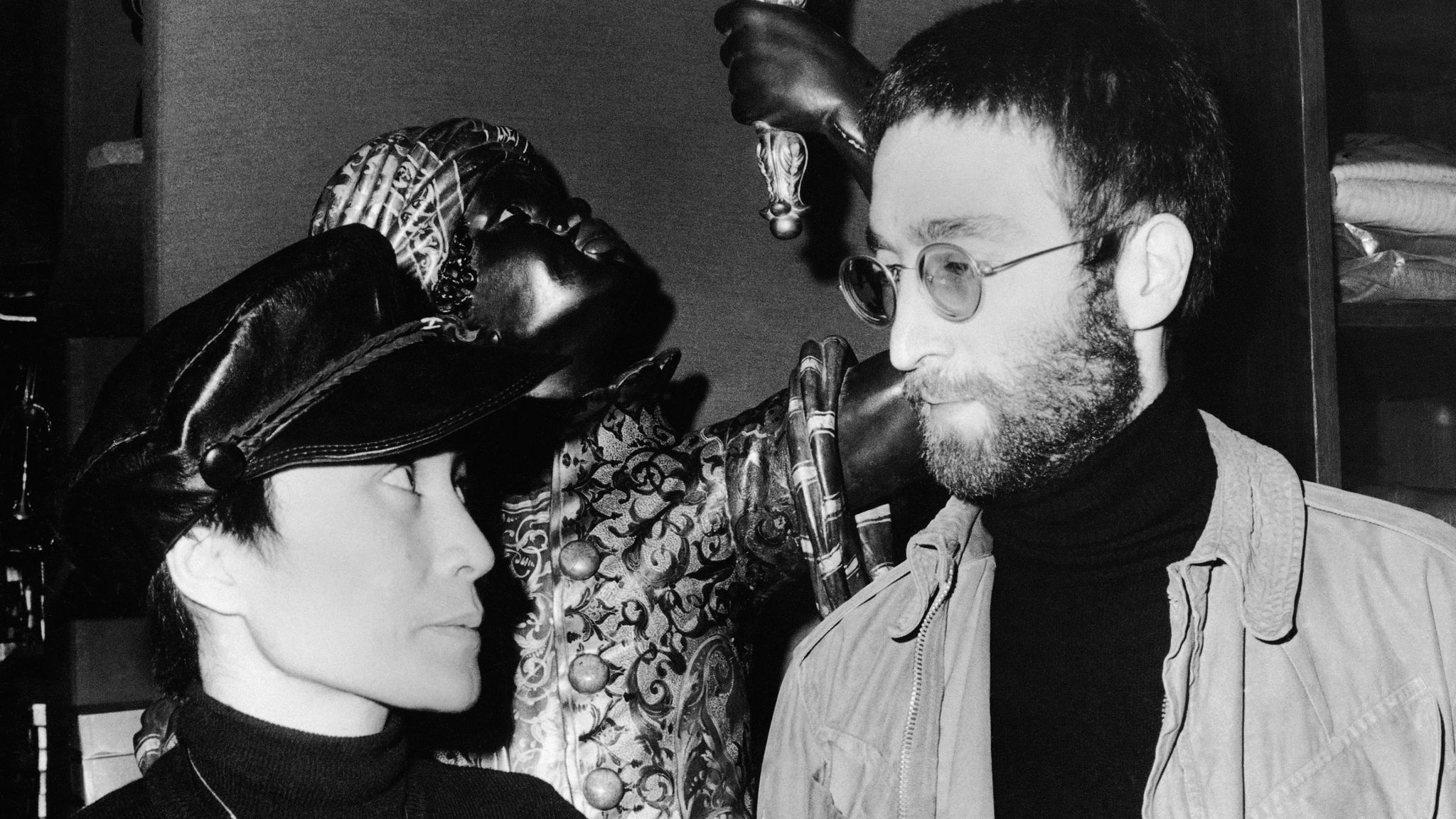 Beatle John Lennon and his wife Yoko Ono arrived in Paris coming from Denmark on January 26, 1970. The Lennons stop at Pierre Cardin's boutique where they did some shopping. (AP Photo)