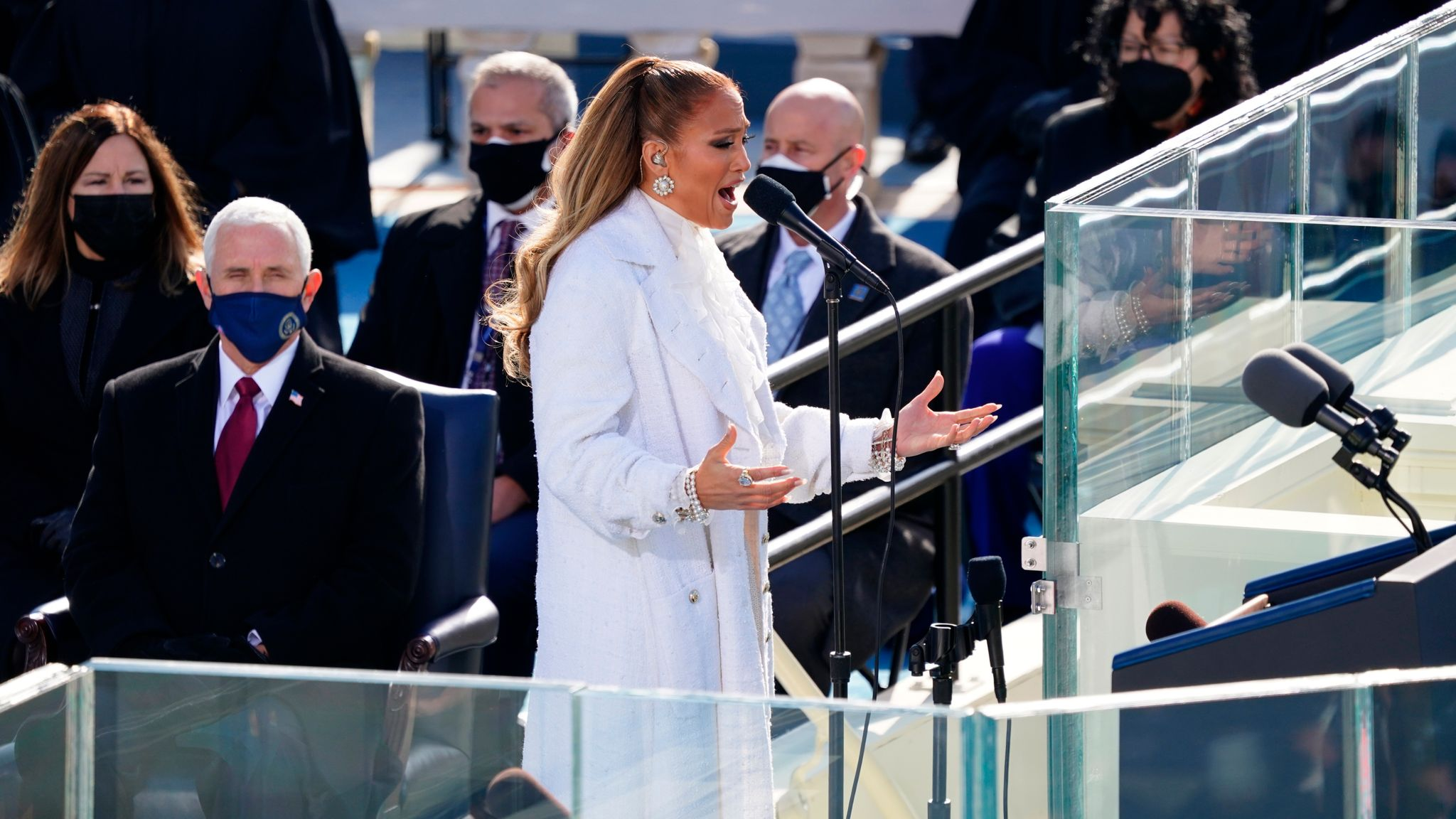 Jennifer Lopez at the inauguration ceremony, as former vice president Mike Pence watches on. Pic: AP