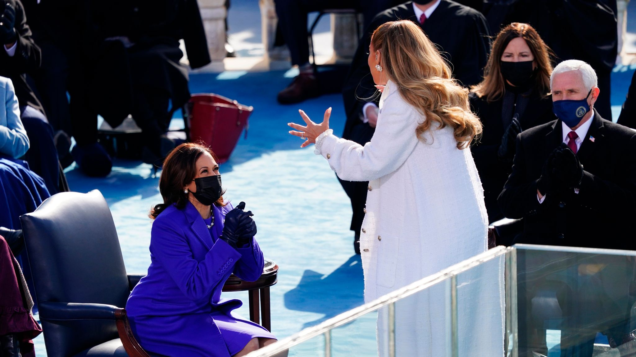 Vice President Kamala Harris reacts after singer Jennifer Lopez performed during the inauguration. Pic: AP