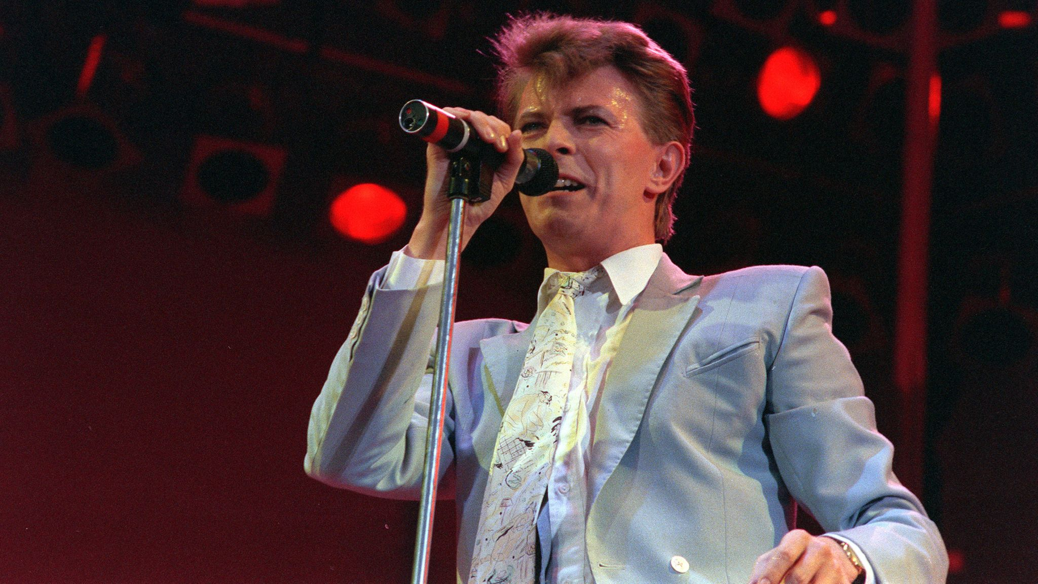 Rock star David Bowie performs on stage at Wembley Stadium, London, July 13, 1985, during the Live Aid famine relief rock concert. (AP Photo/Joe Schaber)