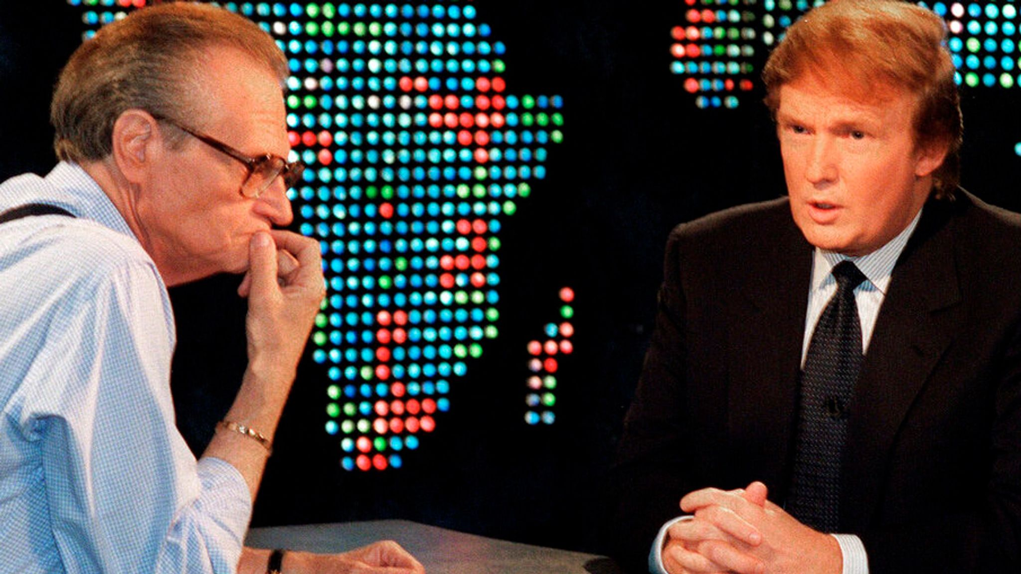 """Donald Trump, right, is interviewed by Larry King during a taping of """"Larry King Live,"""" Thursday, Oct, 7, 1999, in New York. Trump said he has formed an exploratory committee to help him determine whether he can win the White House as a Reform Party candidate. (AP Photo/Marty Lederhandler)"""