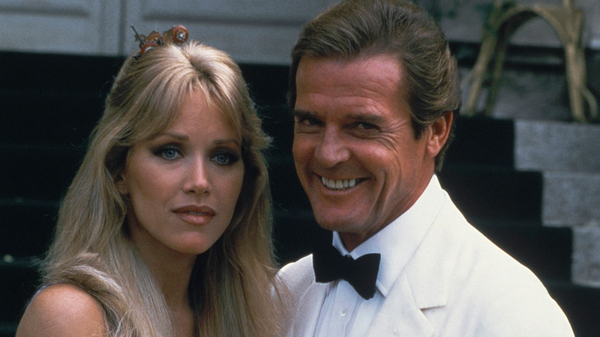 Actor Roger Moore, right, poses with Tanya Roberts, Aug. 17, 1984. (AP Photo/Alexis D.) Photo Details ID: 8408170291 Submission Date: Feb 12, 2009 9:50PM (GMT 21:50) Creation Date: Aug 17, 1984 9:00AM (GMT 08:00)