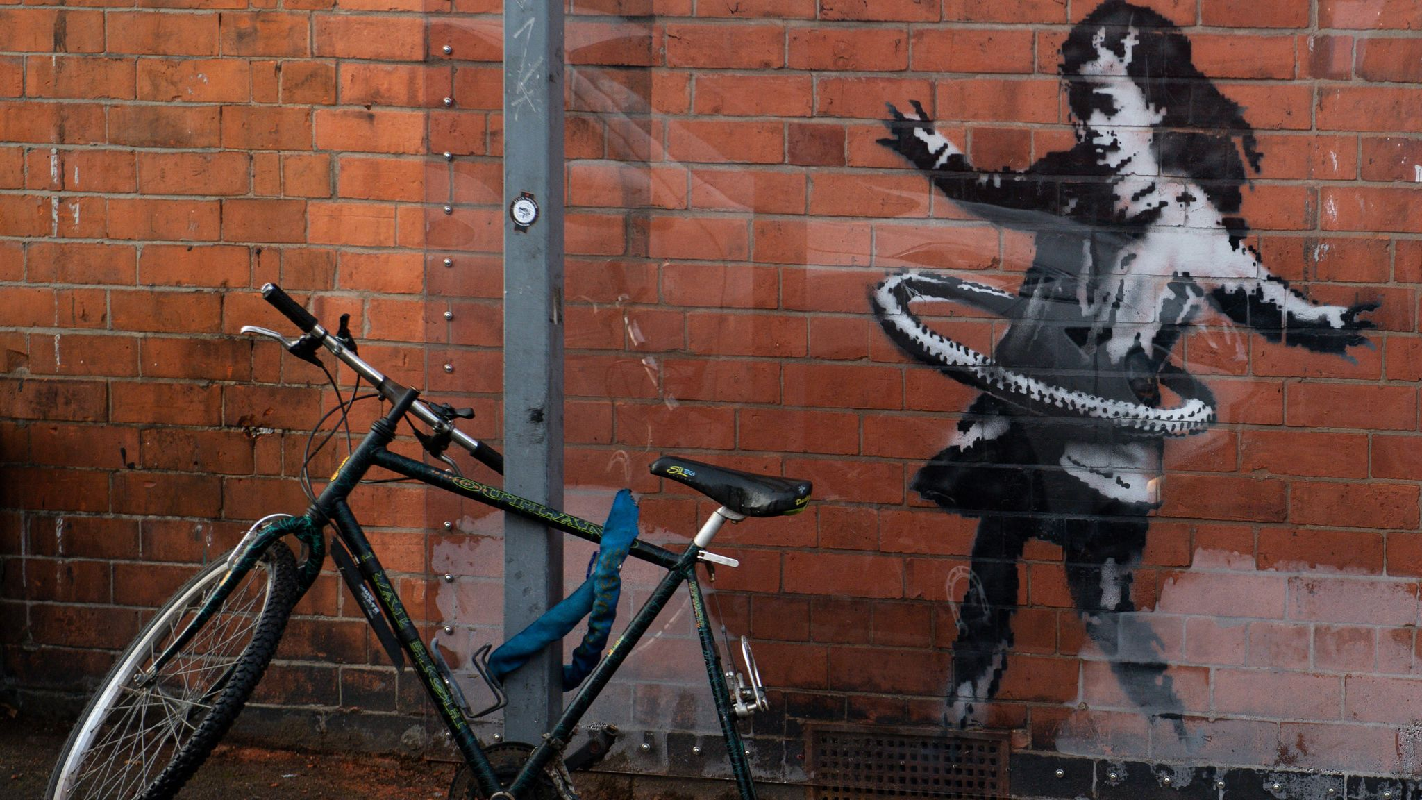 An artwork painted by Banksy on the side of a property at Rothesay Avenue and Ilkeston Road in Nottingham, which has had a replacement bicycle after the original was reportedly stolen over the weekend. Picture date: Monday 23rd November 2020. Photo credit should read: Jacob King/PA Wire