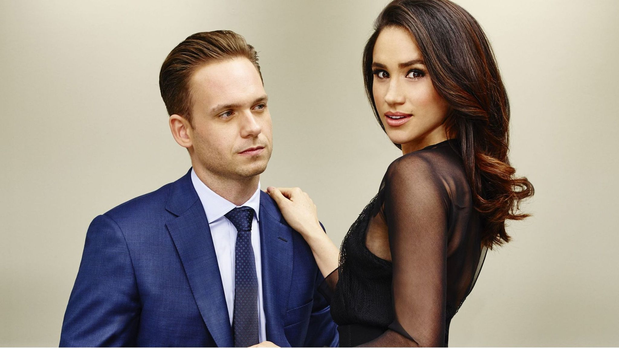 Meghan (then) Markle and Patrick J Adams as Rachel Zane and Mike Ross in Suits