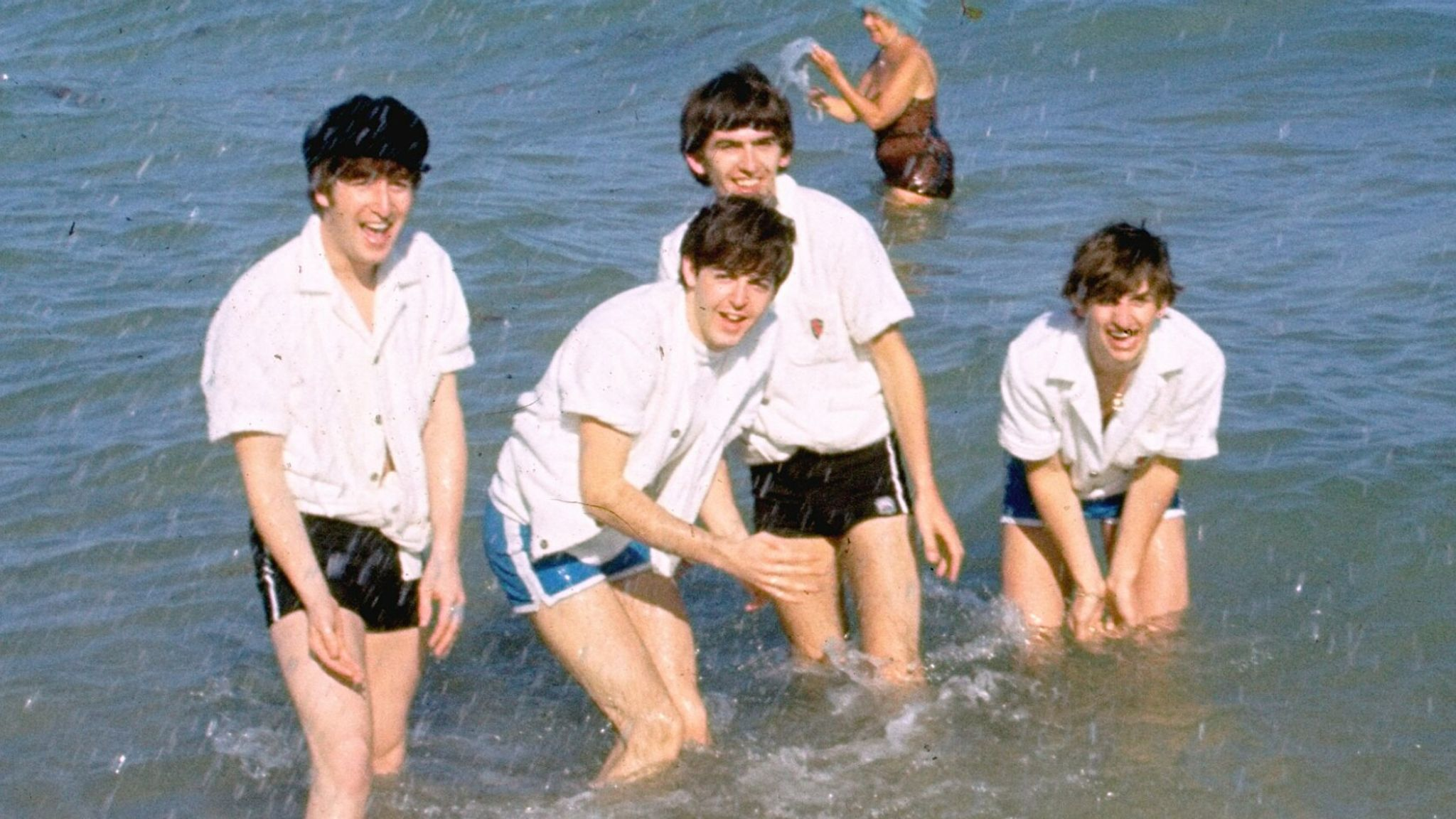 The Beatles - John Lennon, Paul McCartney, George Harrison and Ringo Starr - in the water in Nassau, Bahamas, during filming of Help! in 1965. Pic: AP