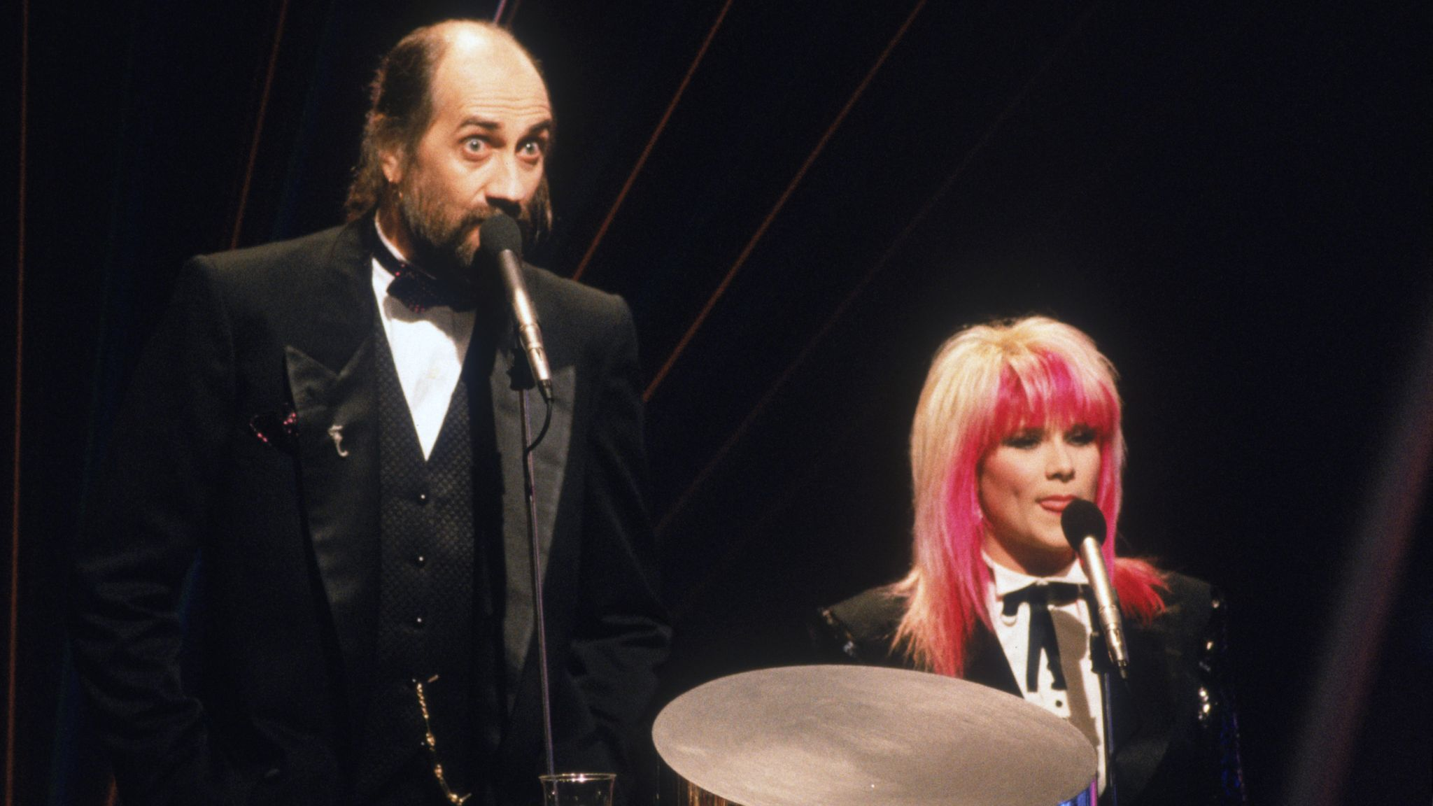 Hosts Mick Fleetwood and Samantha Fox in 1989