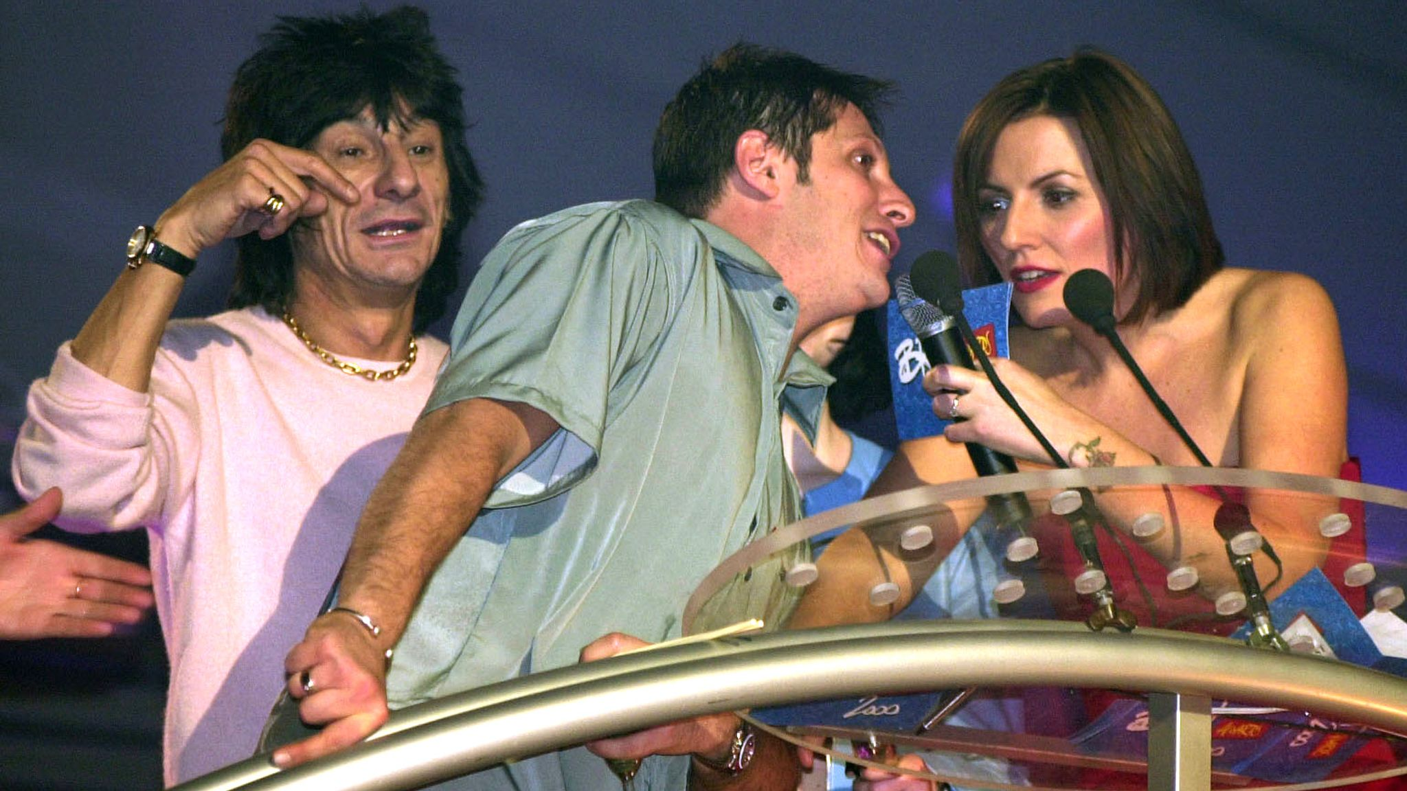 Brandon Block walks on stage to have a word with the ceremony's host Davina McCall, and interrupting Rolling Stones guitarist Ronnie Wood in 2000