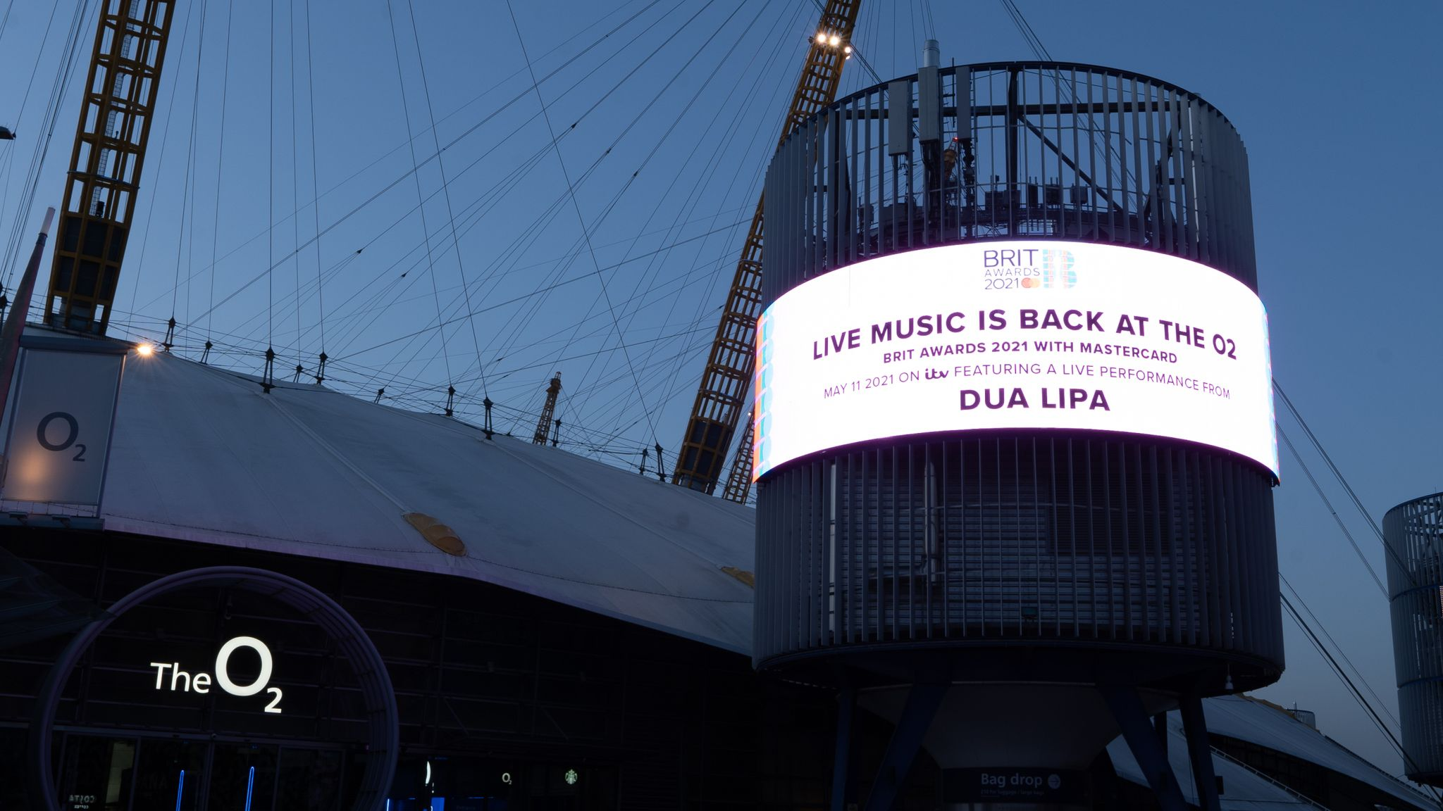 A billboard outside the O2 shows Dua Lipa will be performing at the Brit Awards