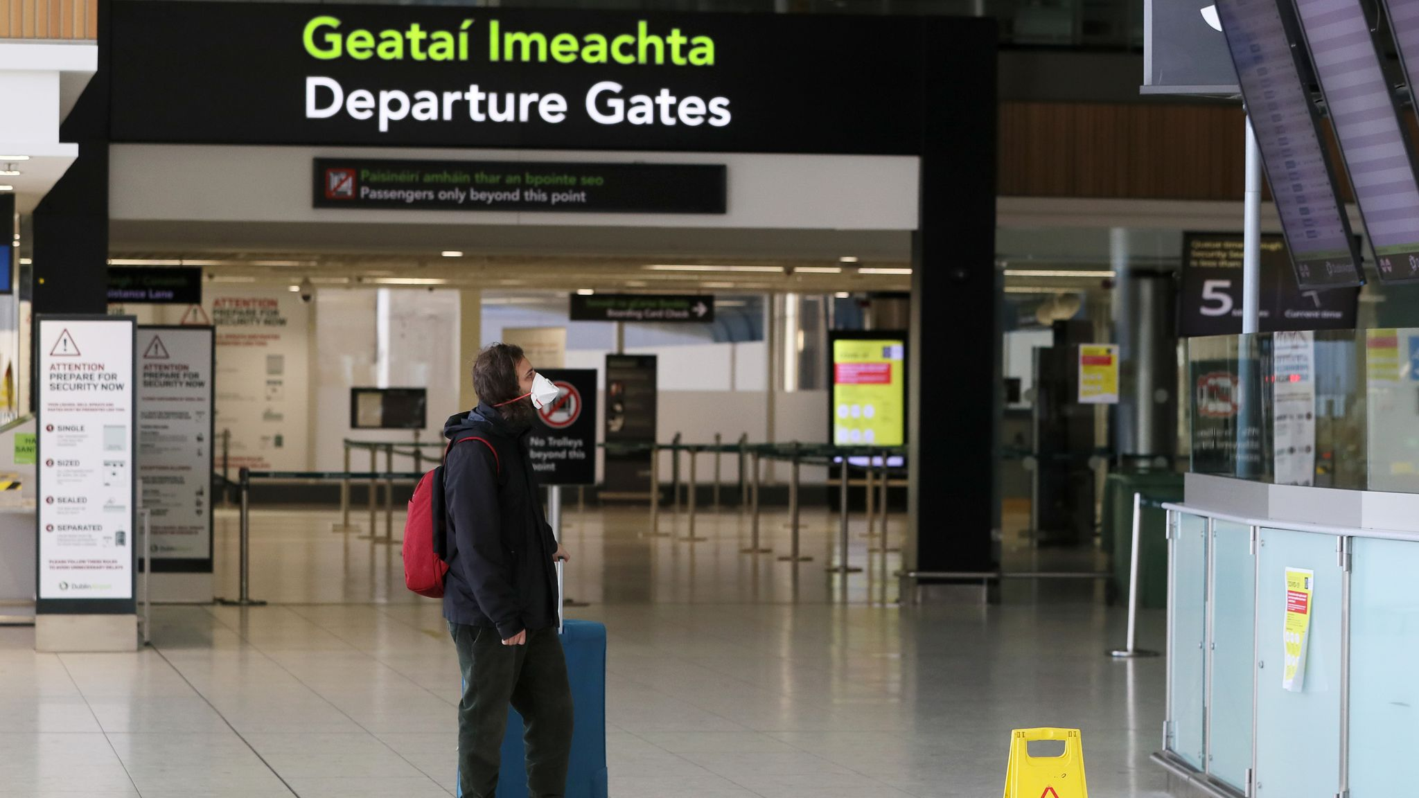 File photo dated 01/05/20 of a man wearing a protective face mask in the departures area of terminal one at Dublin airport. Aer Lingus has announced that a number of regional flights have been cancelled after operator Stobart Air ended its contract with the Irish airline. Issue date: Saturday June 12, 2021.